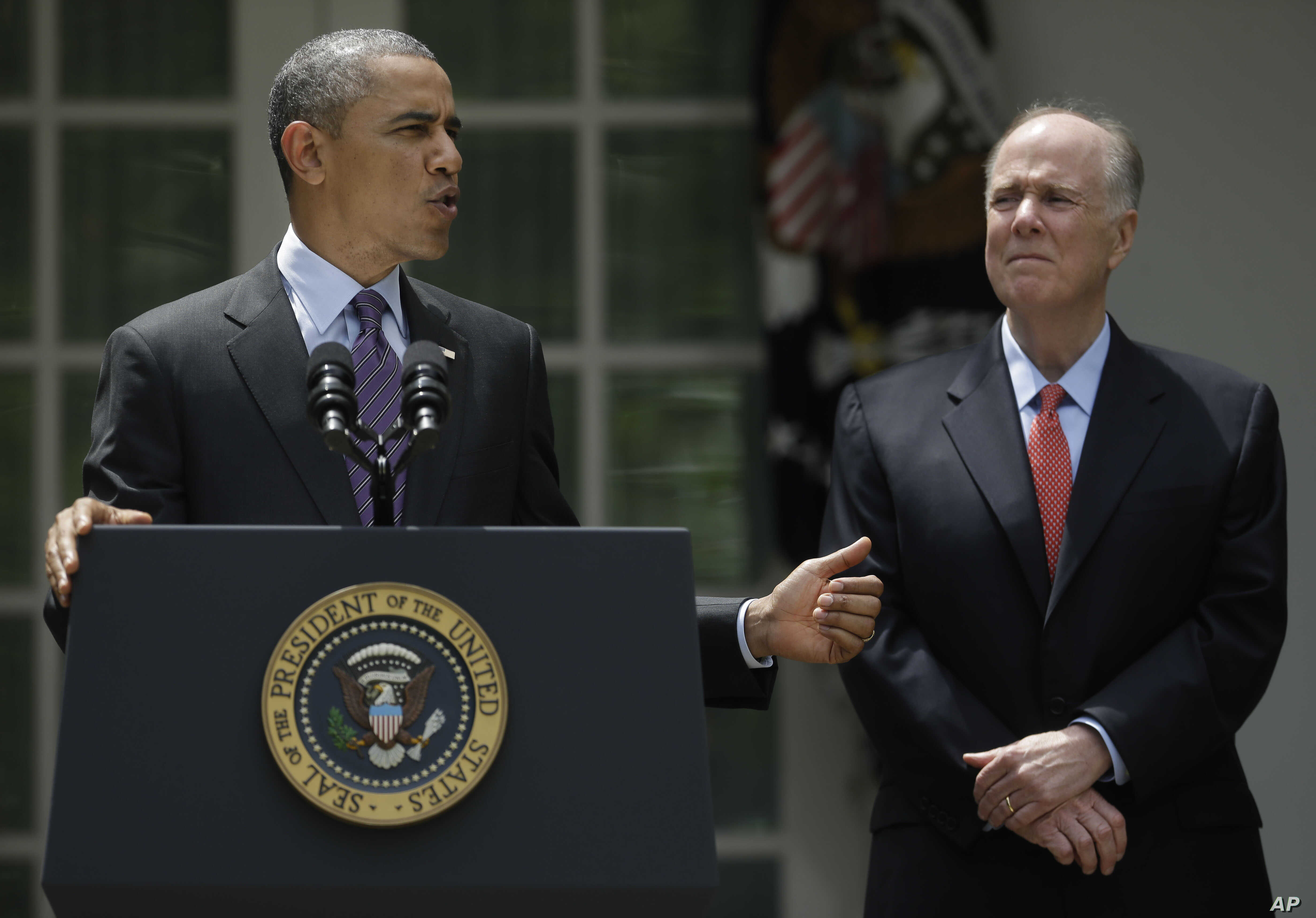 FILE - President Barack Obama, with National Security Advisor Tom Donilon, as he announces his choice for his next National Security Advisor in the Rose Garden of the White House in Washington, June 5, 2013.
