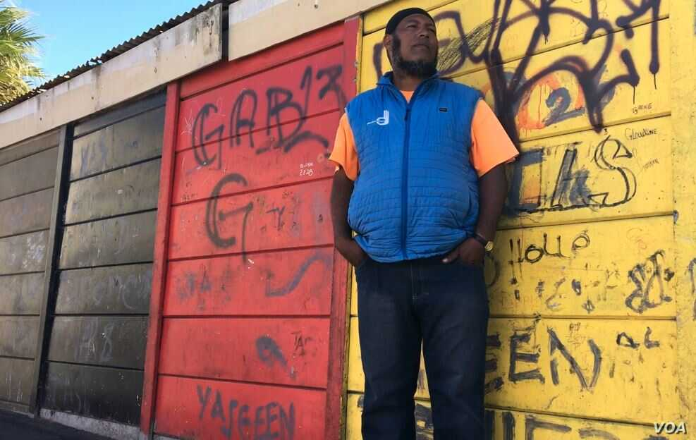 Former gang member Abduraghmaan 'Abi' Ruiters works with CeaseFire as a violence interrupter in Hanover Park township in Cape Town, South Africa. (H. FitzPatrick/VOA)
