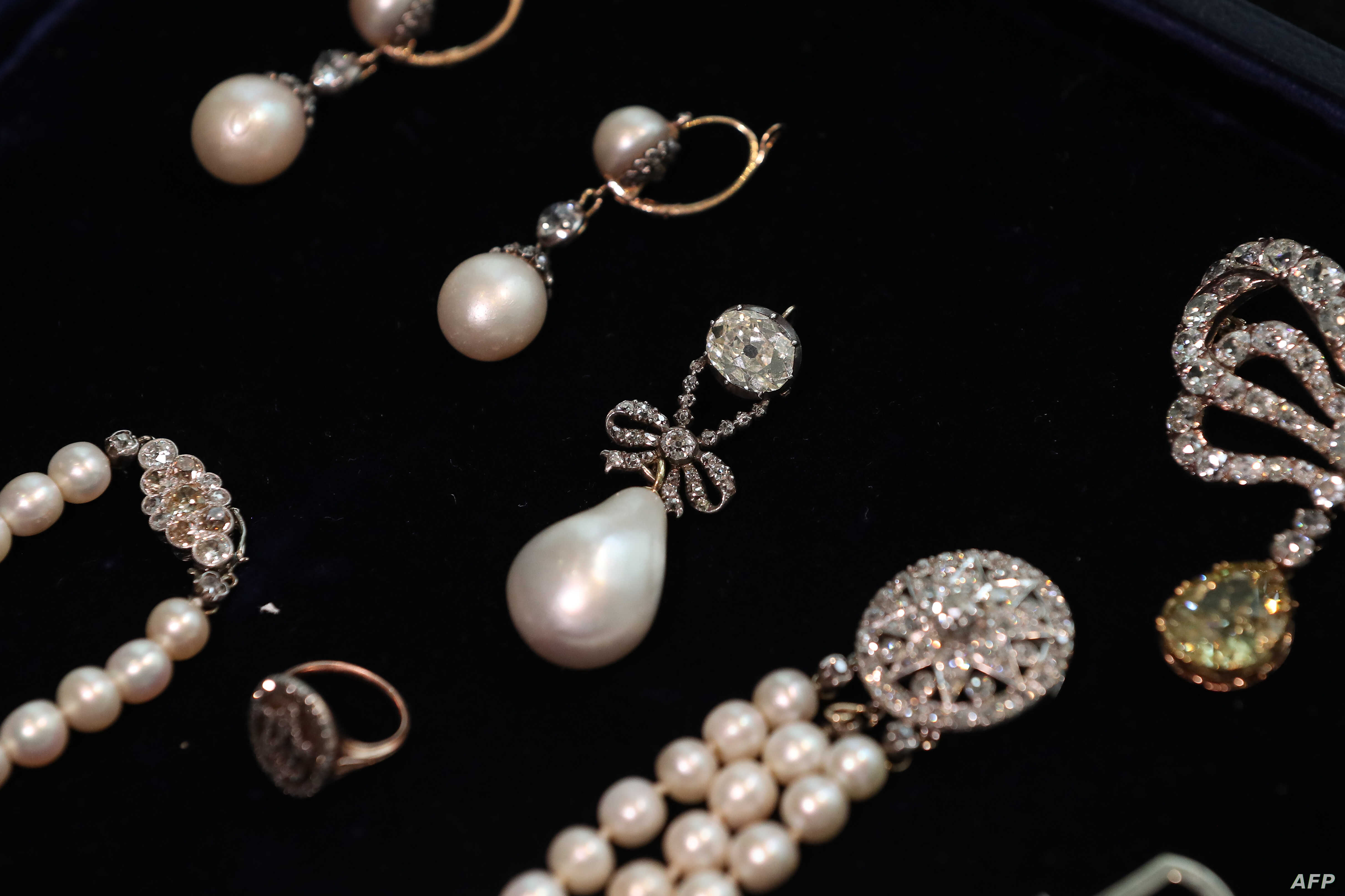 In this file photo taken on Oct. 19, 2018, the 'Queen Marie Antoinette's Pearl,' center, is pictured with other jewellery during a photocall for the sale of 'Royal Jewels from the Bourbon Parma Family.'