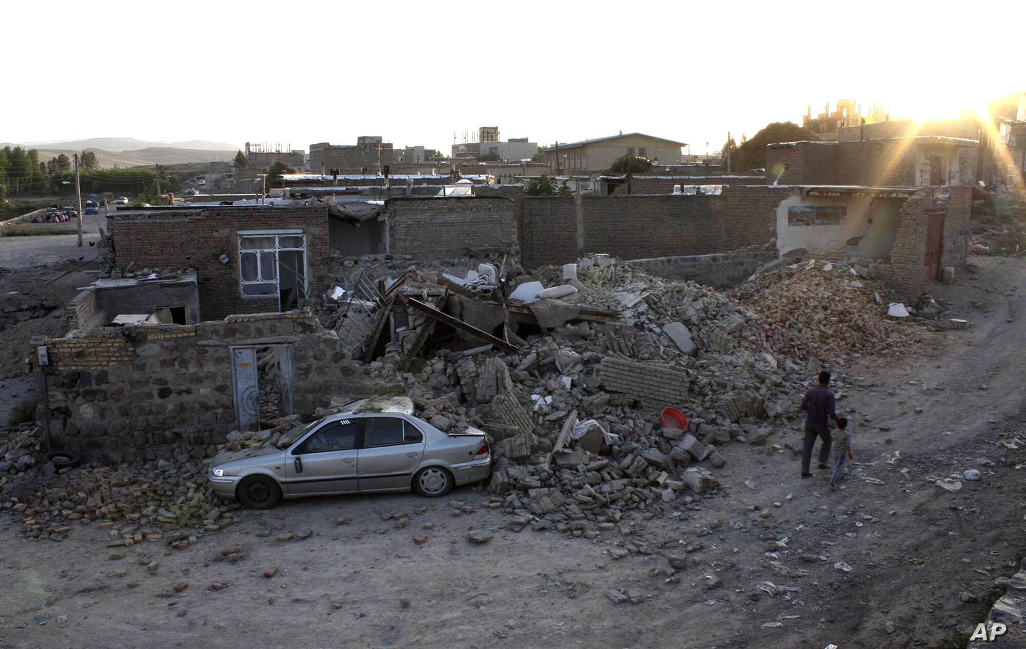 Ruins of a houses are seen after an earthquake in the city of Varzaqan in northwestern Iran, on Saturday, Aug. 11, 2012.