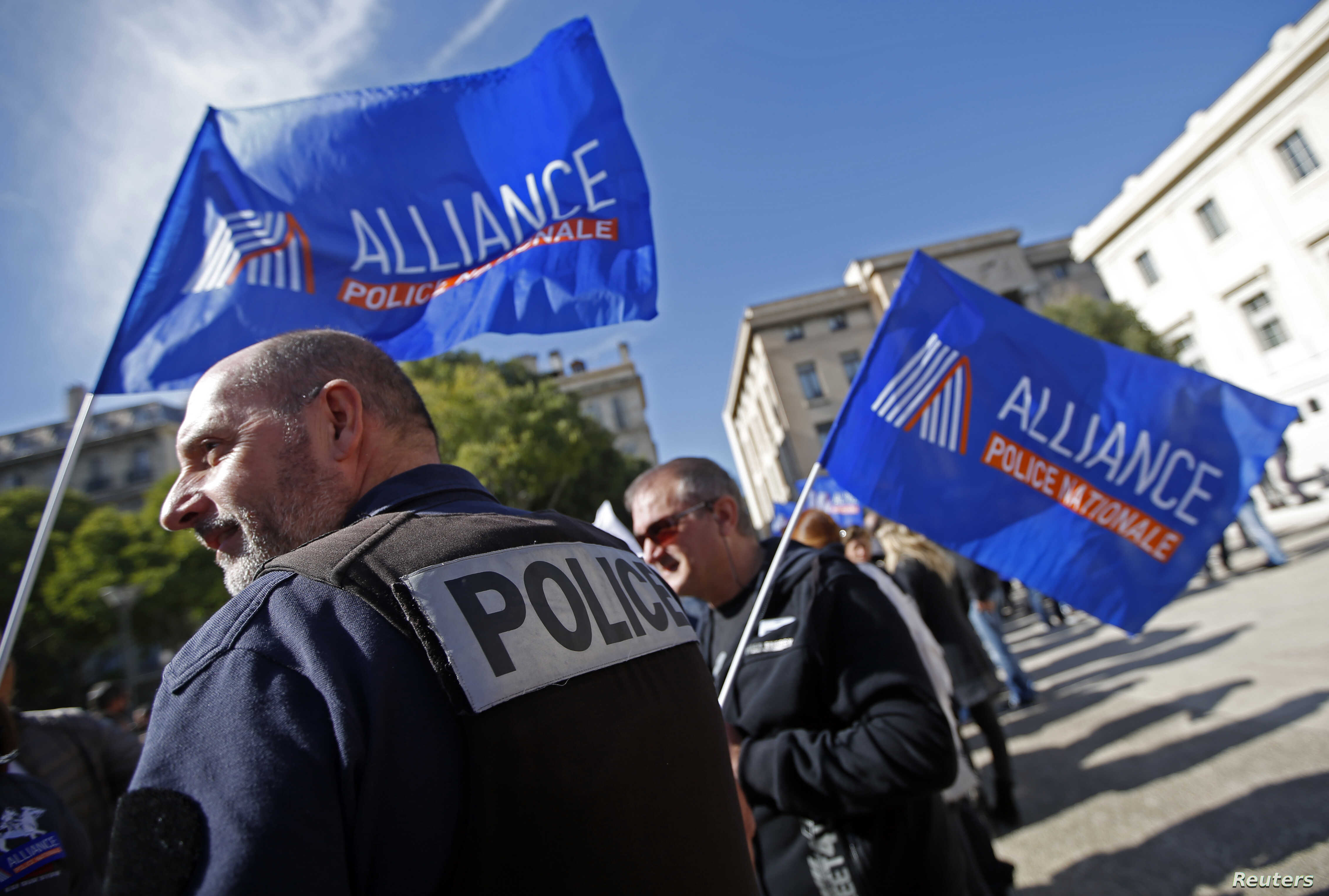 French police, holding labor union banners, rally at the courthouse in Marseille as part of a national protest against what they contend is inadequate judicial support, Oct. 14, 2015.