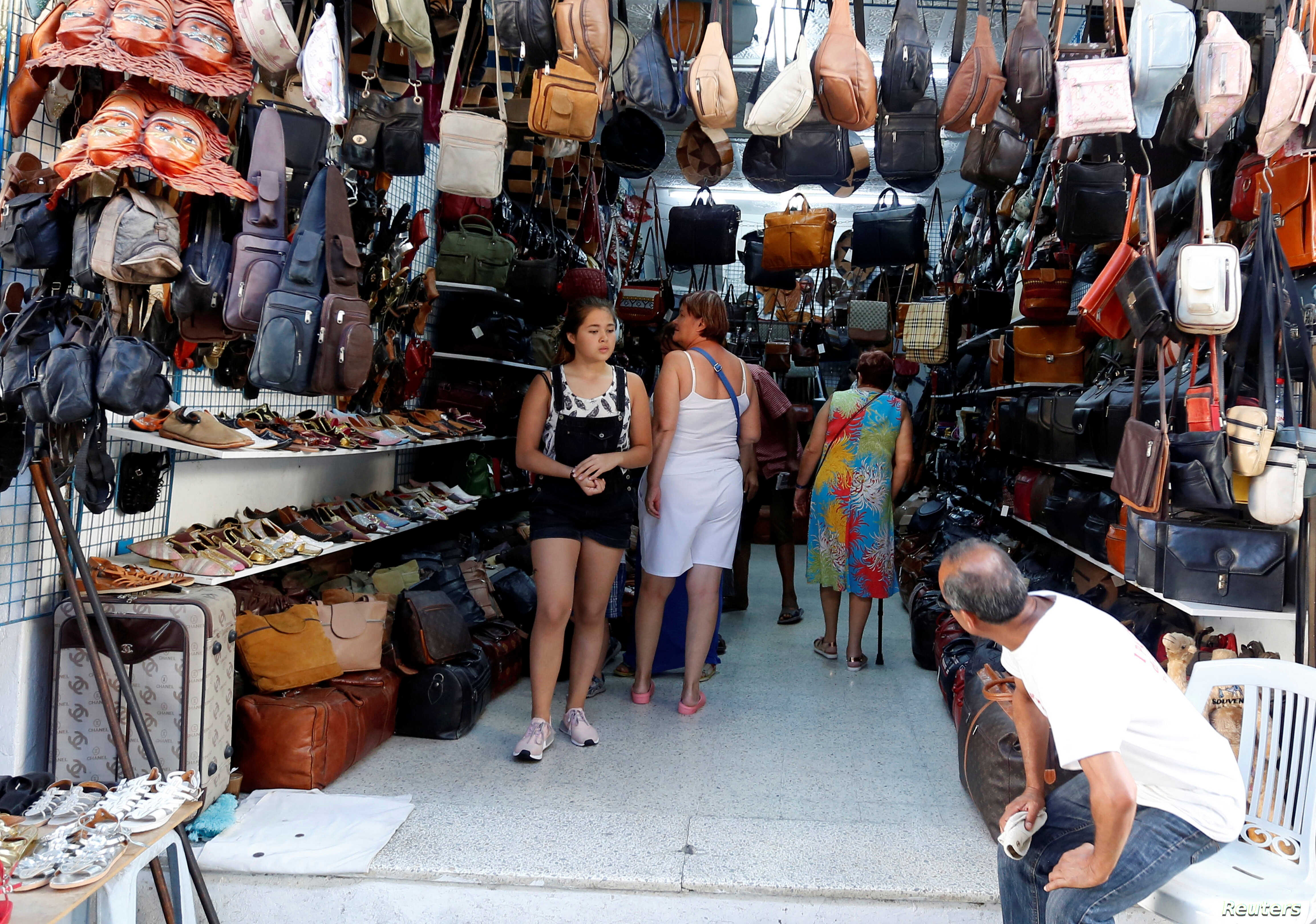 Russian tourists shop at the old medina in Sousse, Tunisia, Sept. 30, 2017.