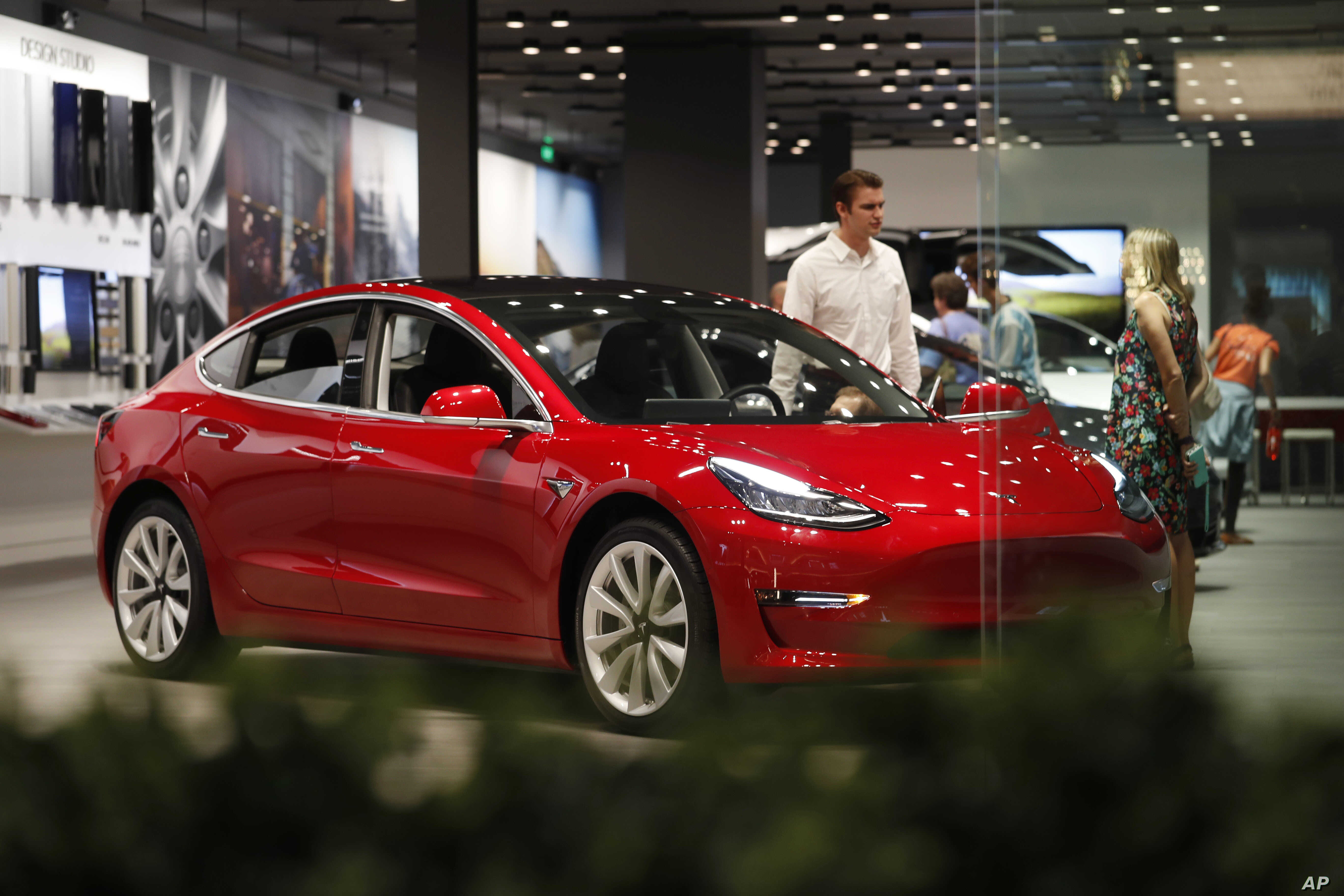 Tesla Shares Drop on Price Cut, Disappointing Model 3 ...