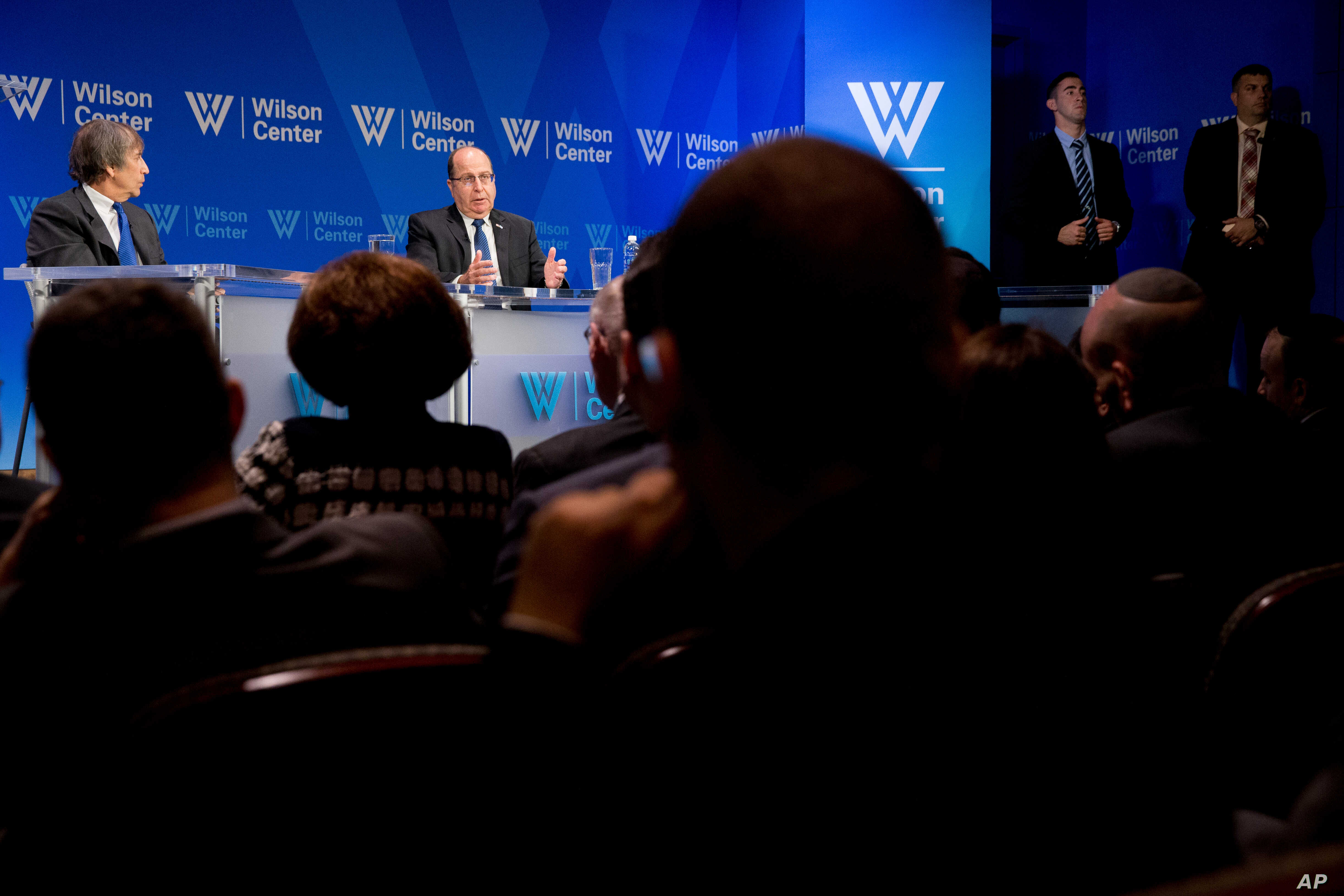 FILE - Wilson Center Vice President for New Initiatives and Distinguished Fellow Aaron David Miller, left, speaks with Israeli Defense Minister Moshe Ya'alon at the Wilson Center, in Washington, Monday, March 14, 2016.