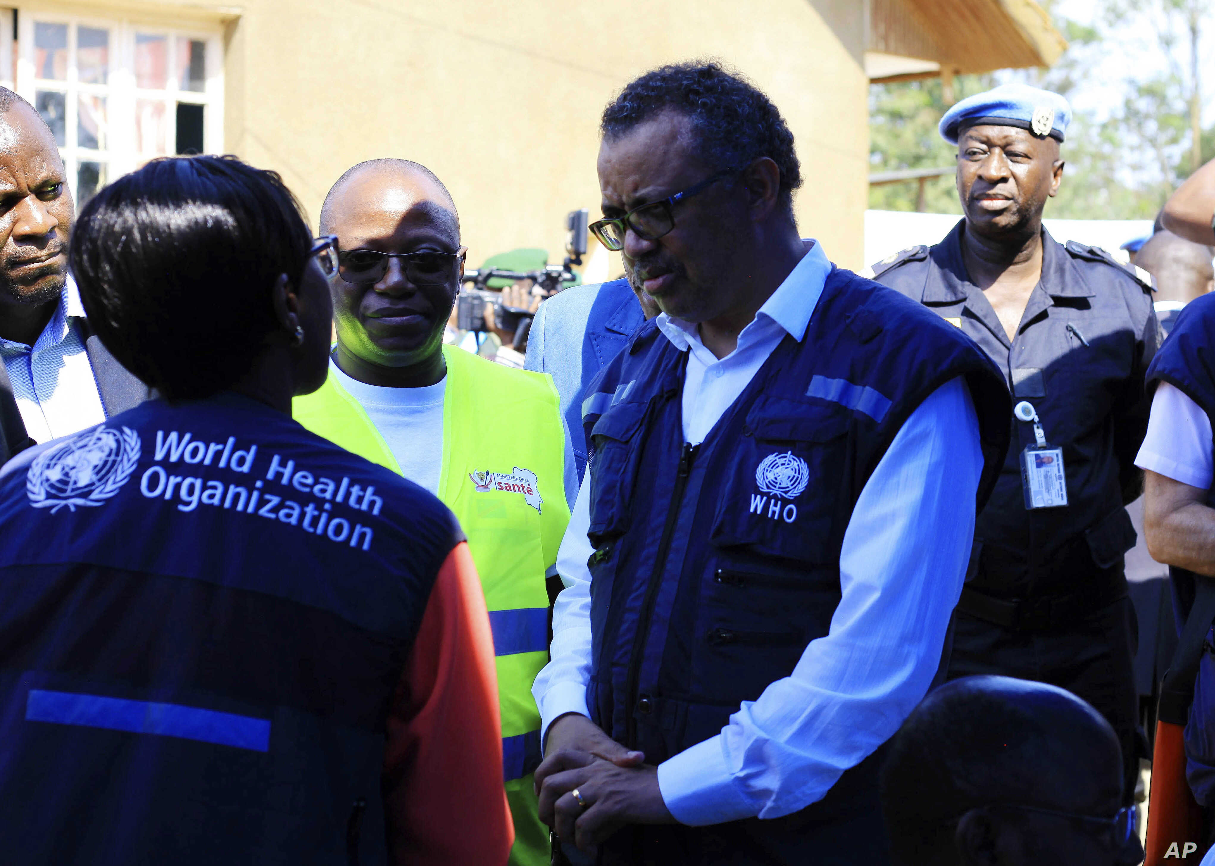 Dr. Tedros Adhanom Ghebreyesus, WHO Director General, centre, speaks to a health official at a newly established Ebola response center in Beni, Democratic Republic of Congo, Friday, Aug. 10, 2018.