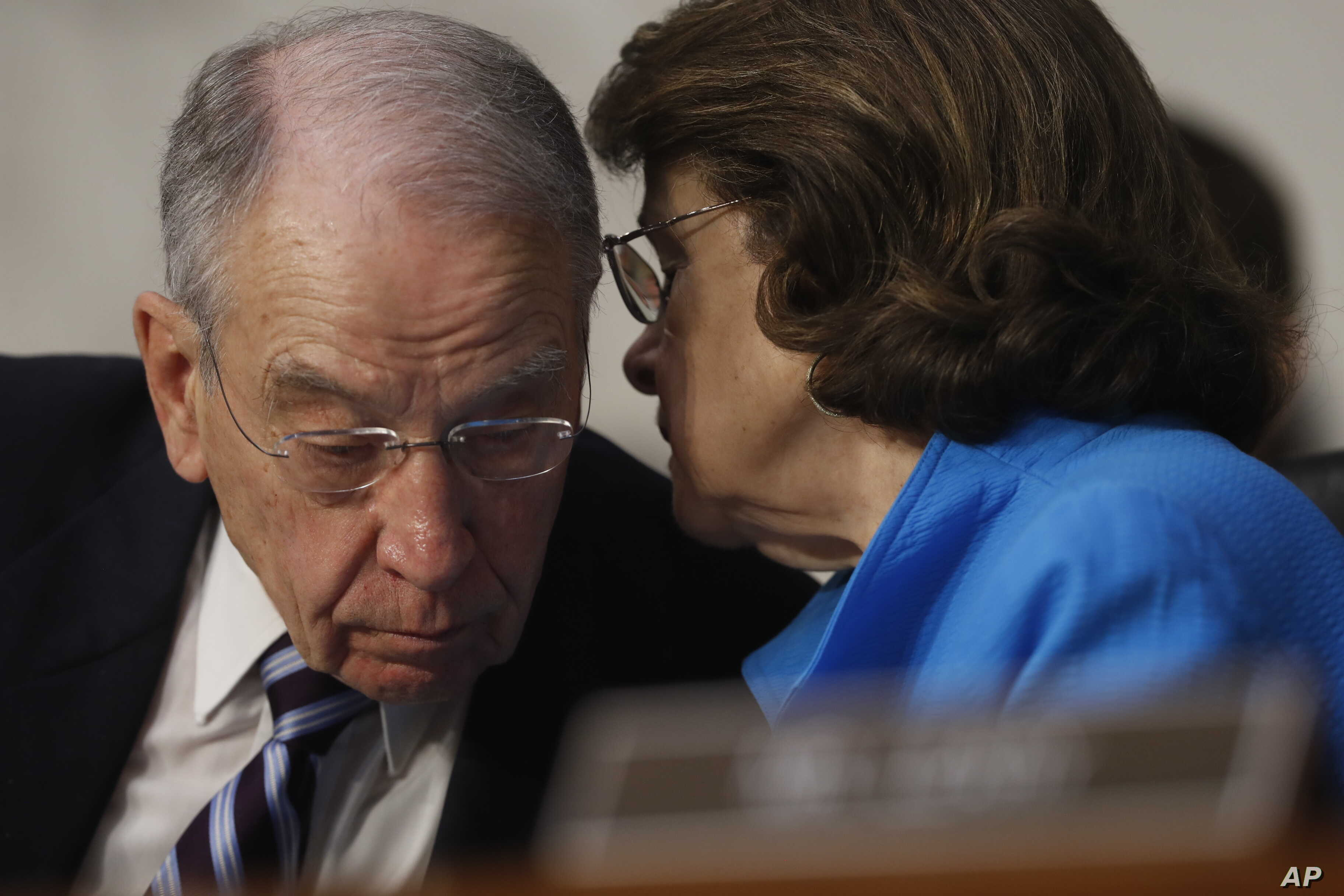 Senate Judiciary Committee Chairman Sen. Charles Grassley, R-Iowa, confers with the committee's ranking member Sen. Dianne Feinstein, D-Calif., on Capitol Hill in Washington, March 20, 2017, during the committee's confirmation hearing for Supreme Co...