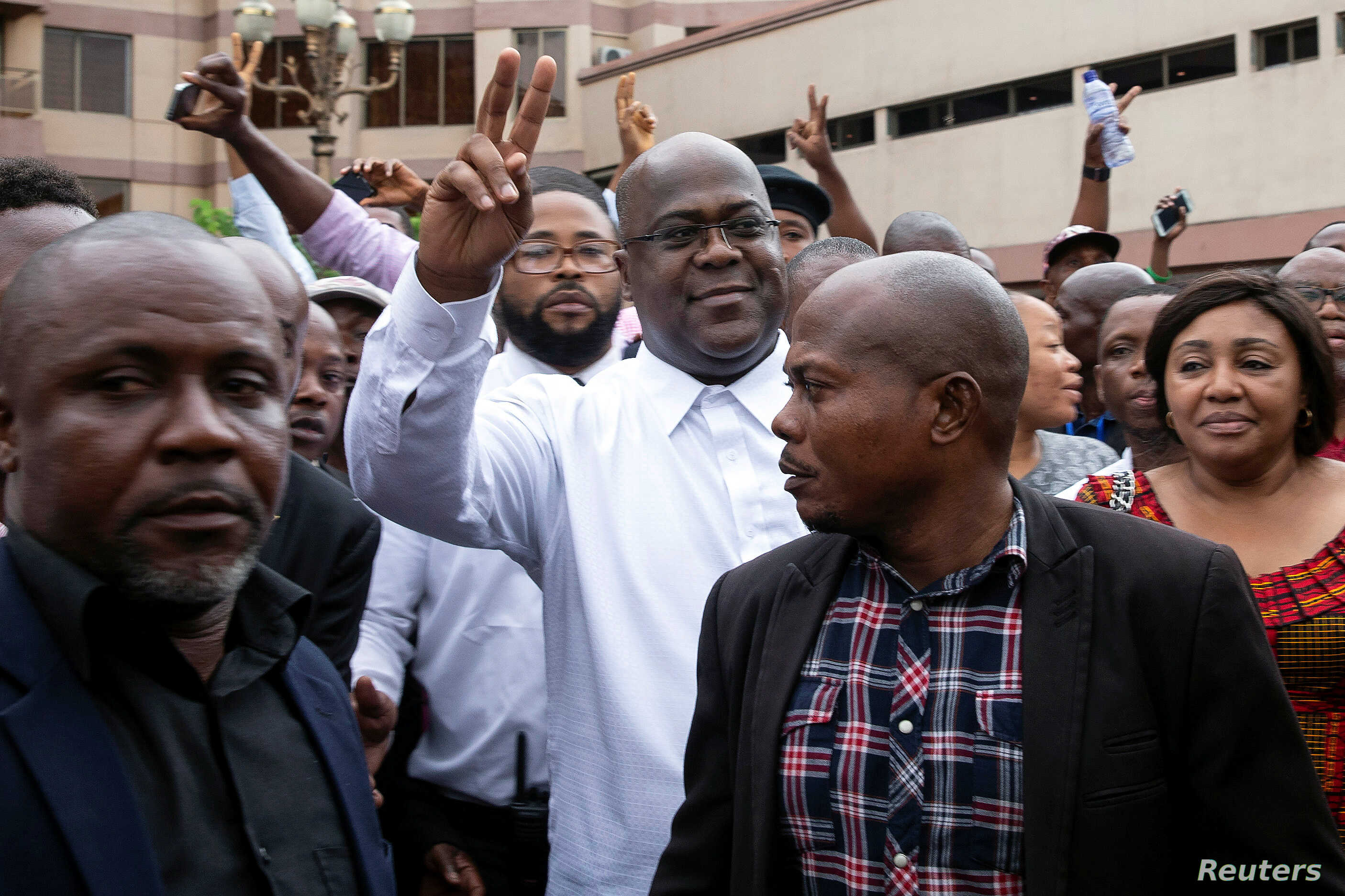 Felix Tshisekedi, leader main DRC opposition party, Union for Democracy and Social Progress (UDPS) who has been declared the winner of the presidential elections, gestures to his supporters in Kinshasa, Jan. 10, 2019.