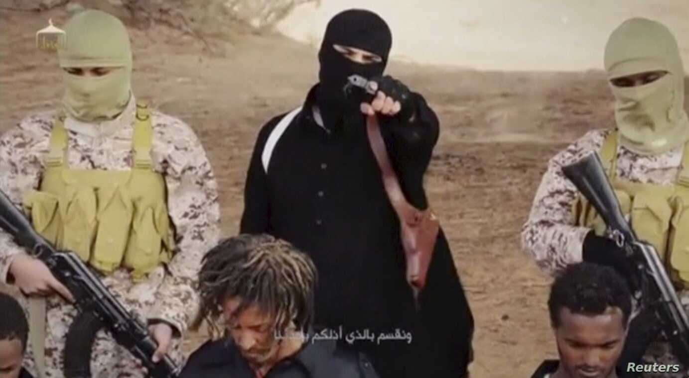 An Islamic State militant holds a gun while standing behind what are said to be Ethiopian Christians in Wilayat Fazzan, in this still image from an undated video made available on a social media website on April 19, 2015.