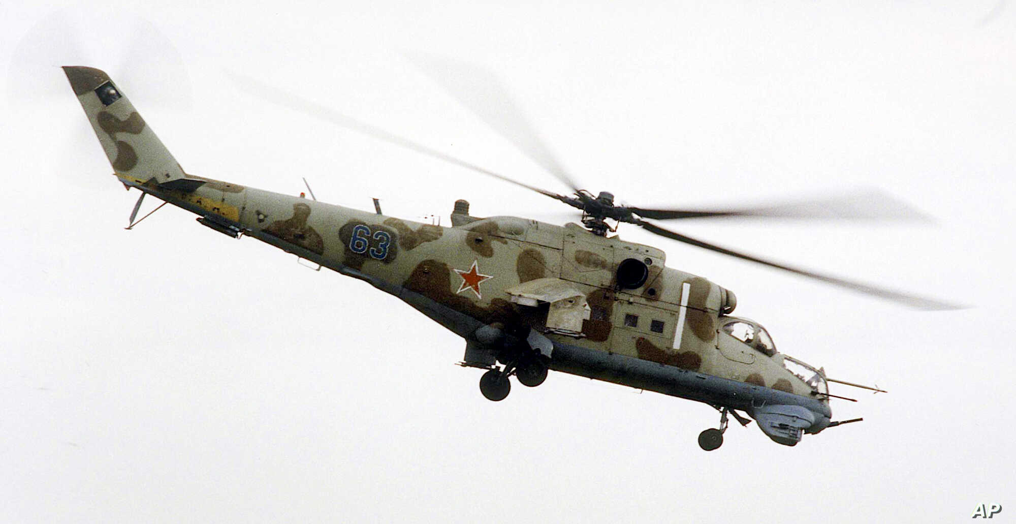 A Mi-24 helicopter gunship , the same model as the one that crashed Sunday in Syria, flies above the southern Russian city of Rostov-on-Don in this 2000 file photo.