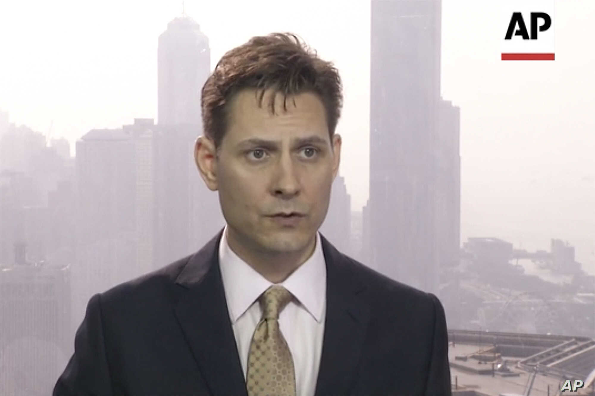 In this image made from a video taken on March 28, 2018, North East Asia senior adviser Michael Kovrig speaks during an interview in Hong Kong.