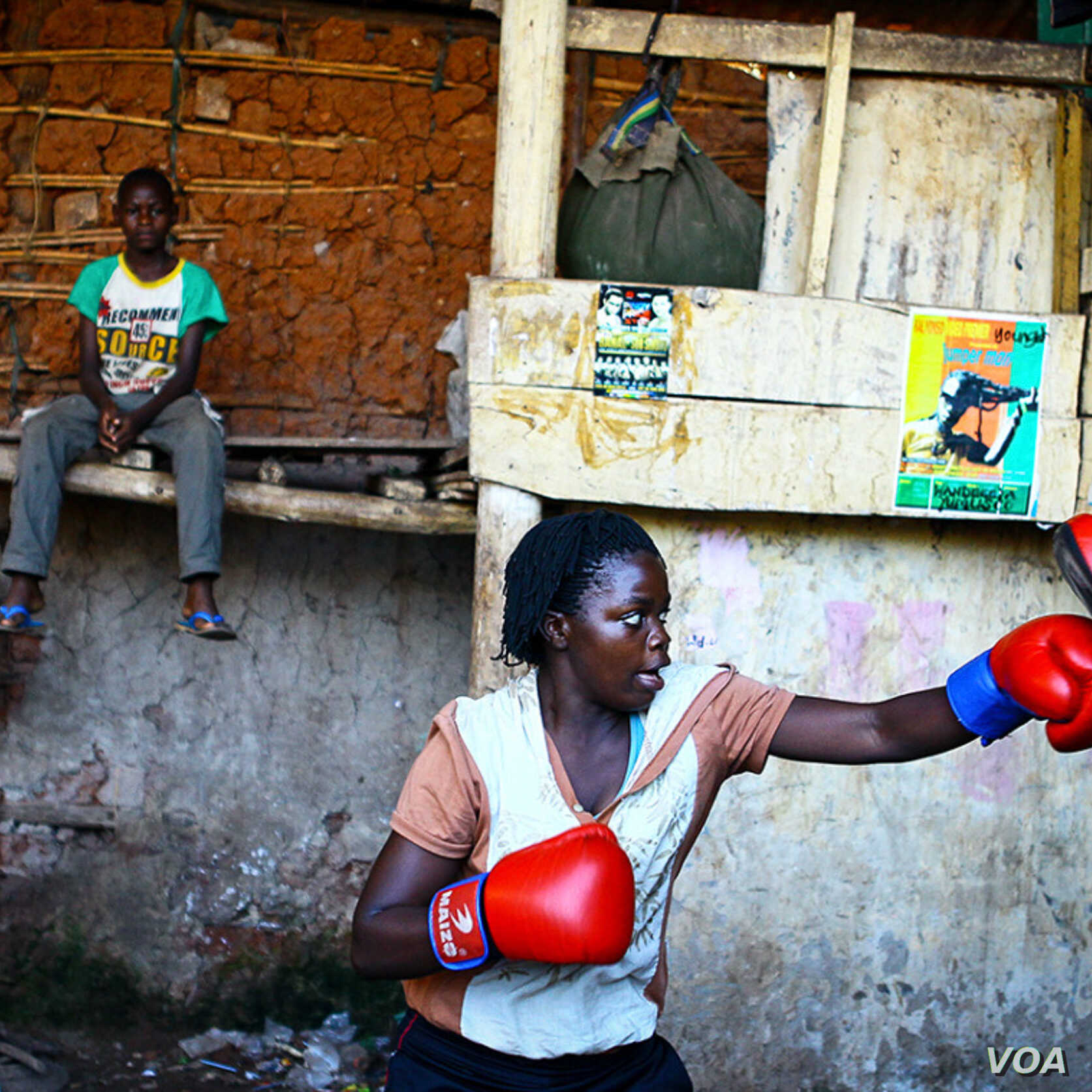 Edward Echwalu:A female boxer trains inside a makeshift gym in Katanga, Kampala, Uganda.