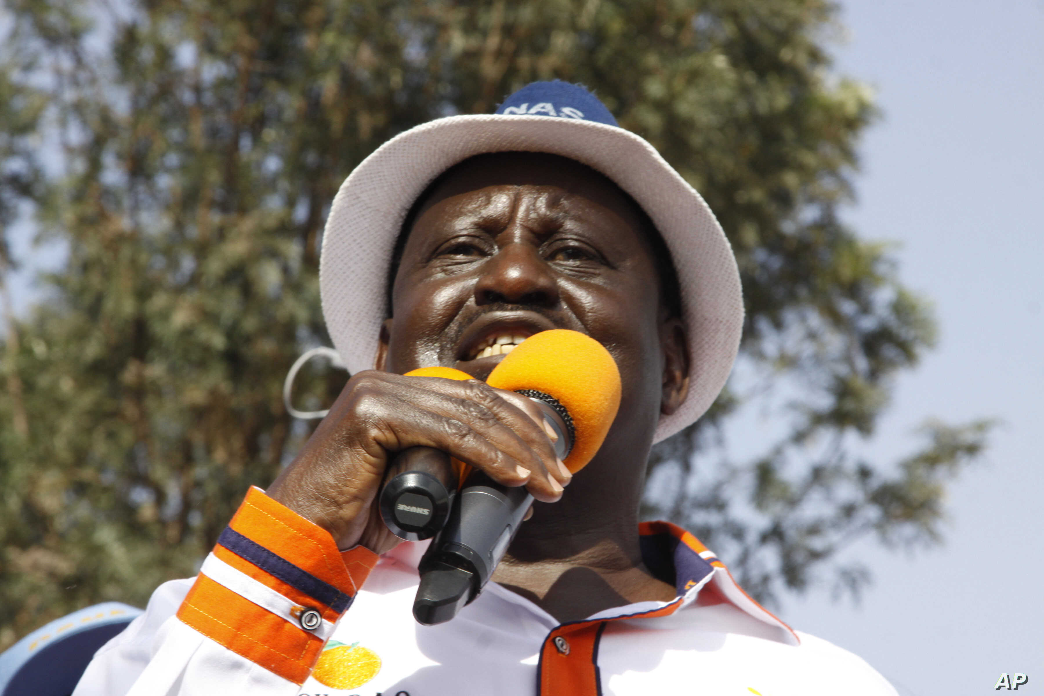Kenyan opposition leader Raila Odinga addresses a crowd of his supporters in the Kibera area at an election rally in Nairobi, Kenya, Sept. 12, 2017.