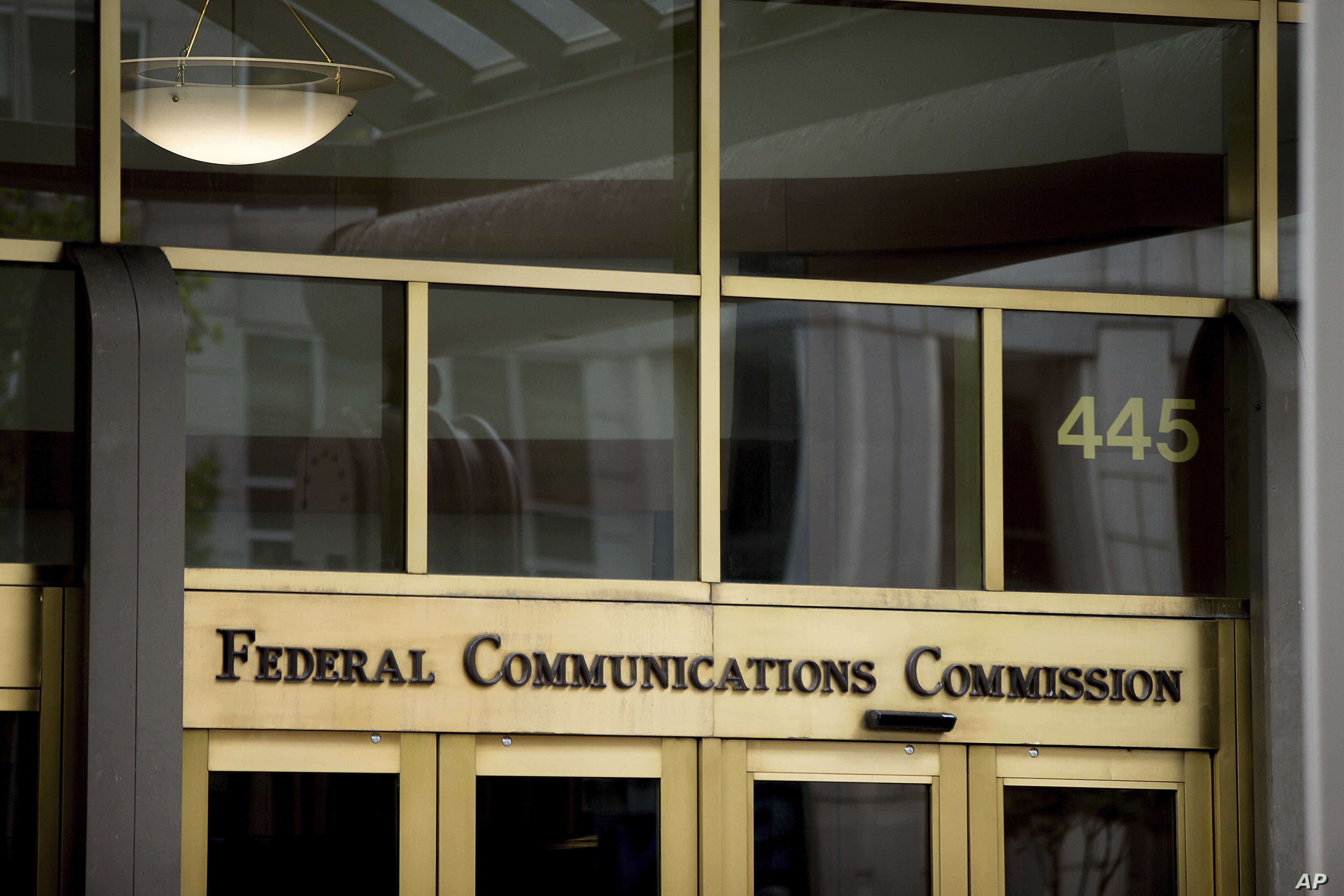 FILE - This June 19, 2015, file photo, shows the Federal Communications Commission building in Washington. Federal Communications Commission Chairman Ajit Pai this month announced new cuts to phone subsidies that could disproportionately impact Nativ...