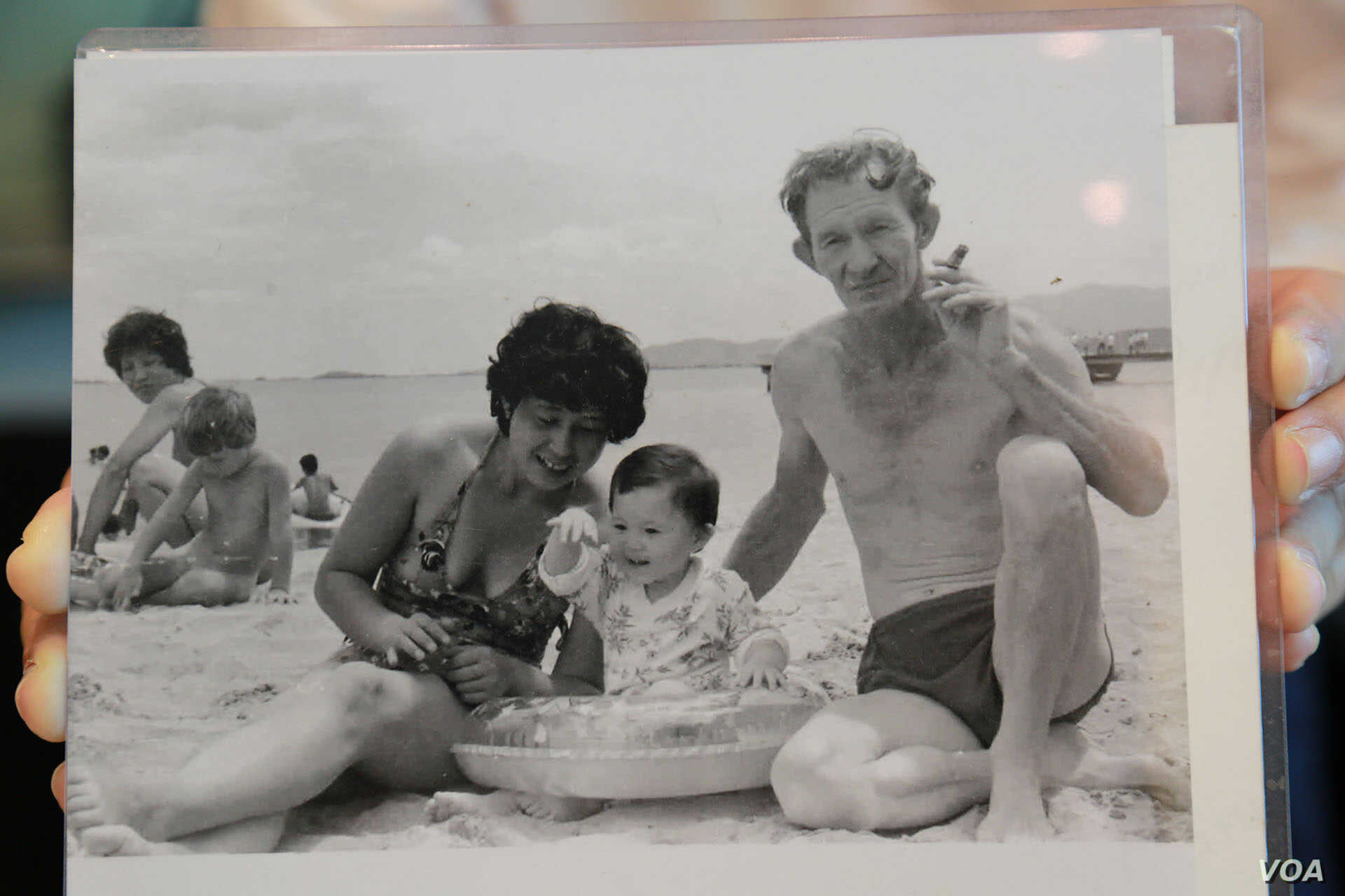 A 1984 photograph of American Charles Robert Jenkins and his wife and child on a beach. Anocha Panjoy's family have identified her as the woman in the background.