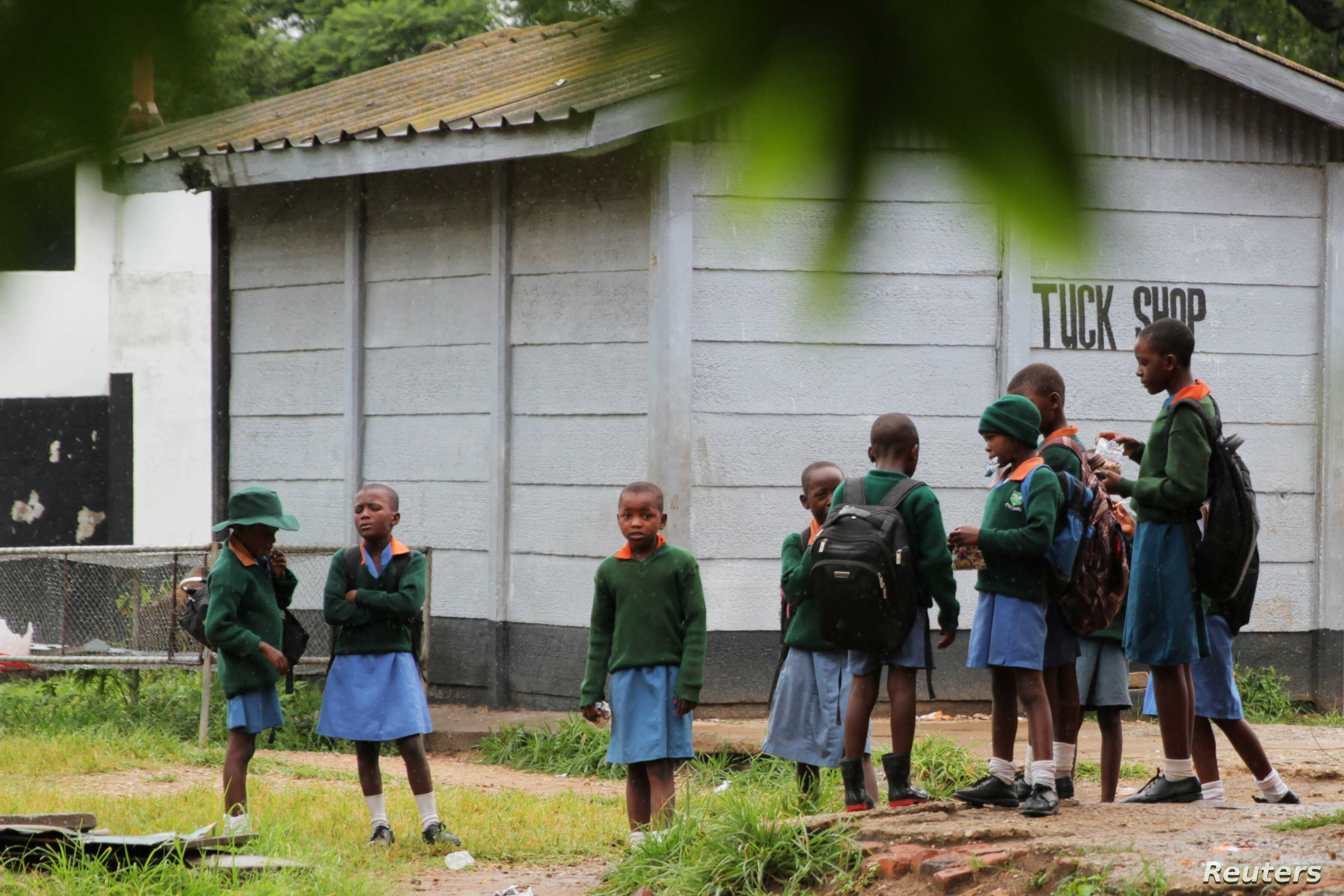 Pupils stand outside classrooms at a government school in the capital city of Harare, Zimbabwe February 5, 2019.