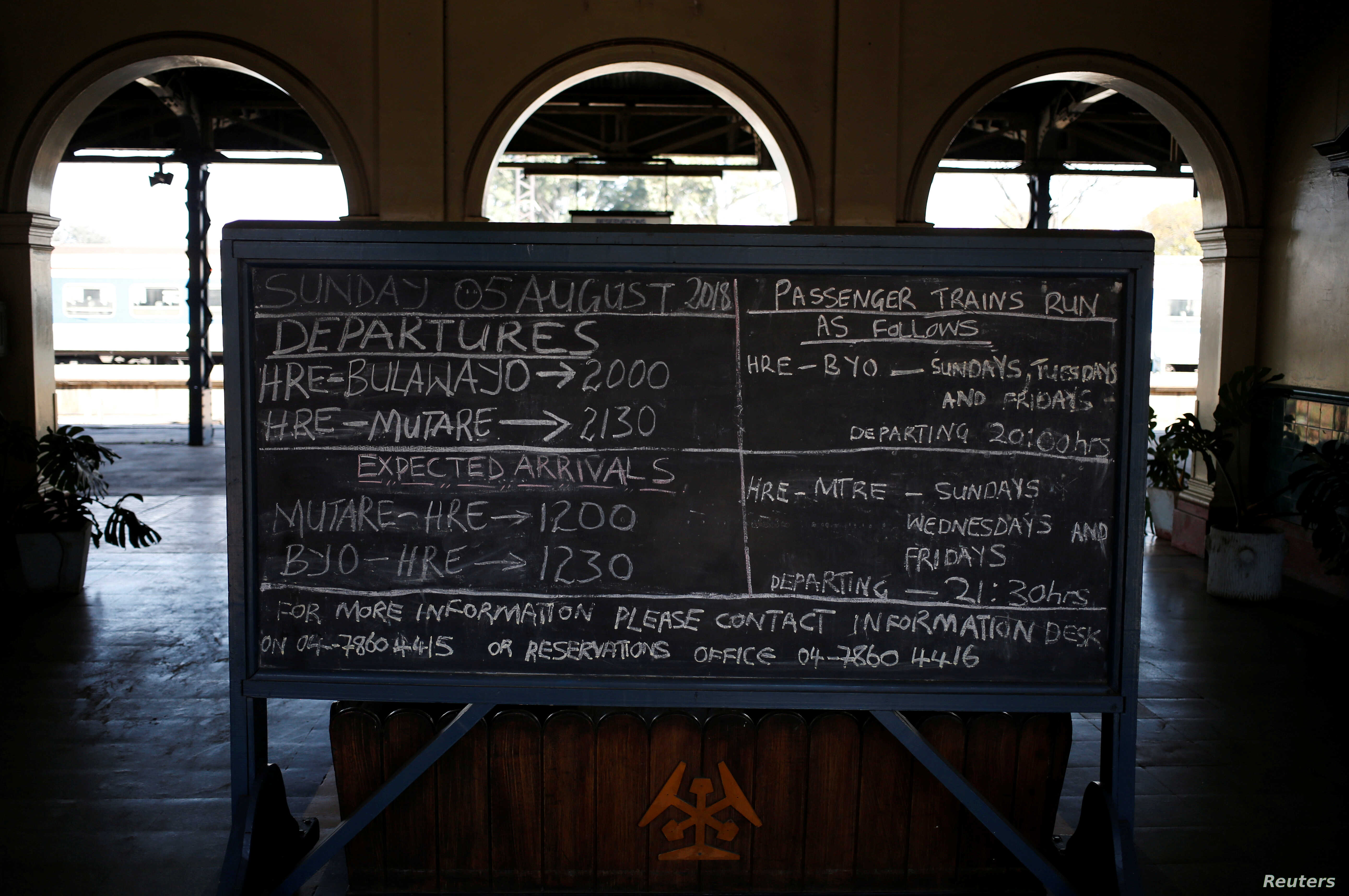A train schedule is written on a chalk board at a train station in Harare, Zimbabwe, Aug. 5, 2018.