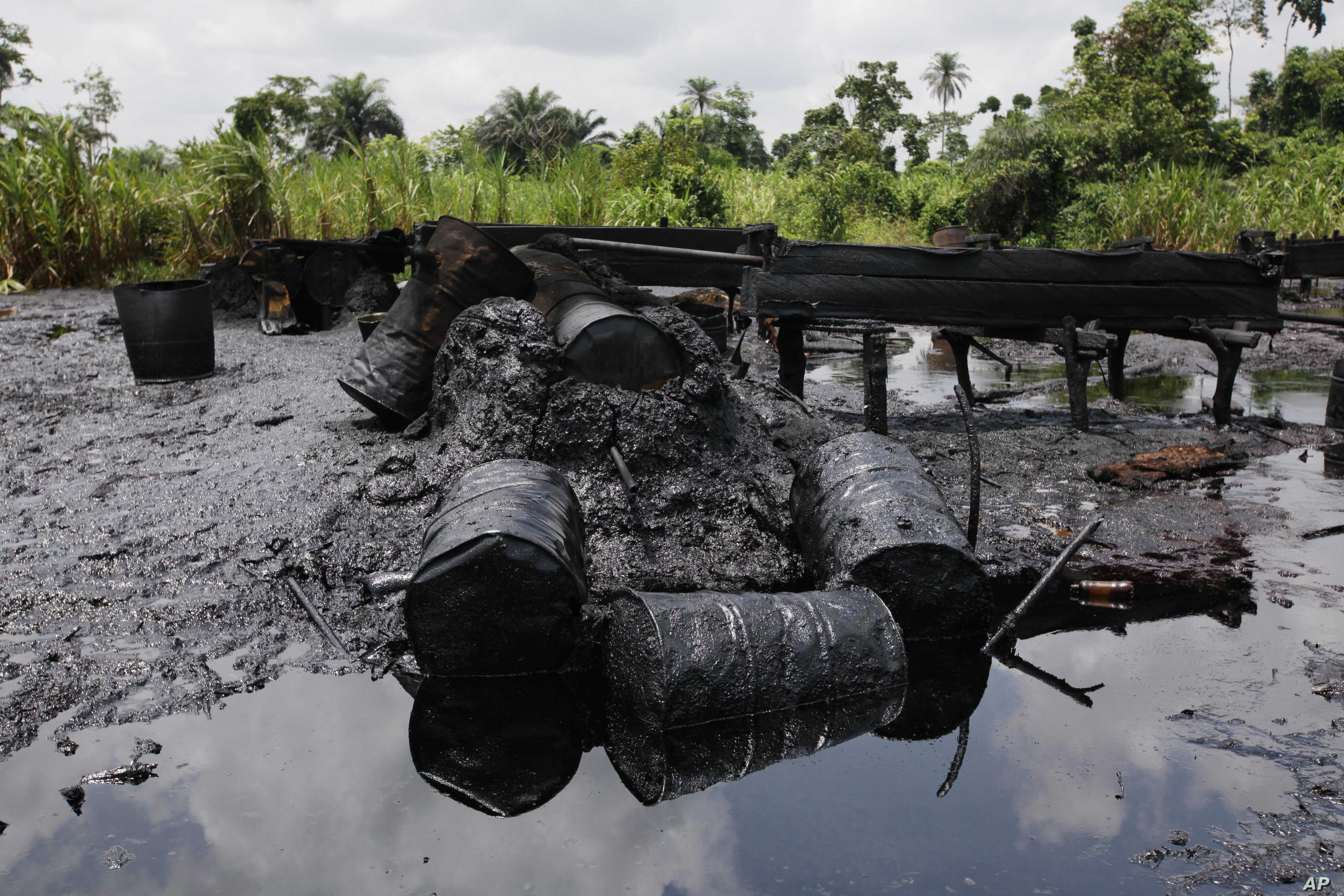 FILE - An abandoned illegal refinery is seen at the creeks of Bayelsa, Nigeria, May 18, 2013.