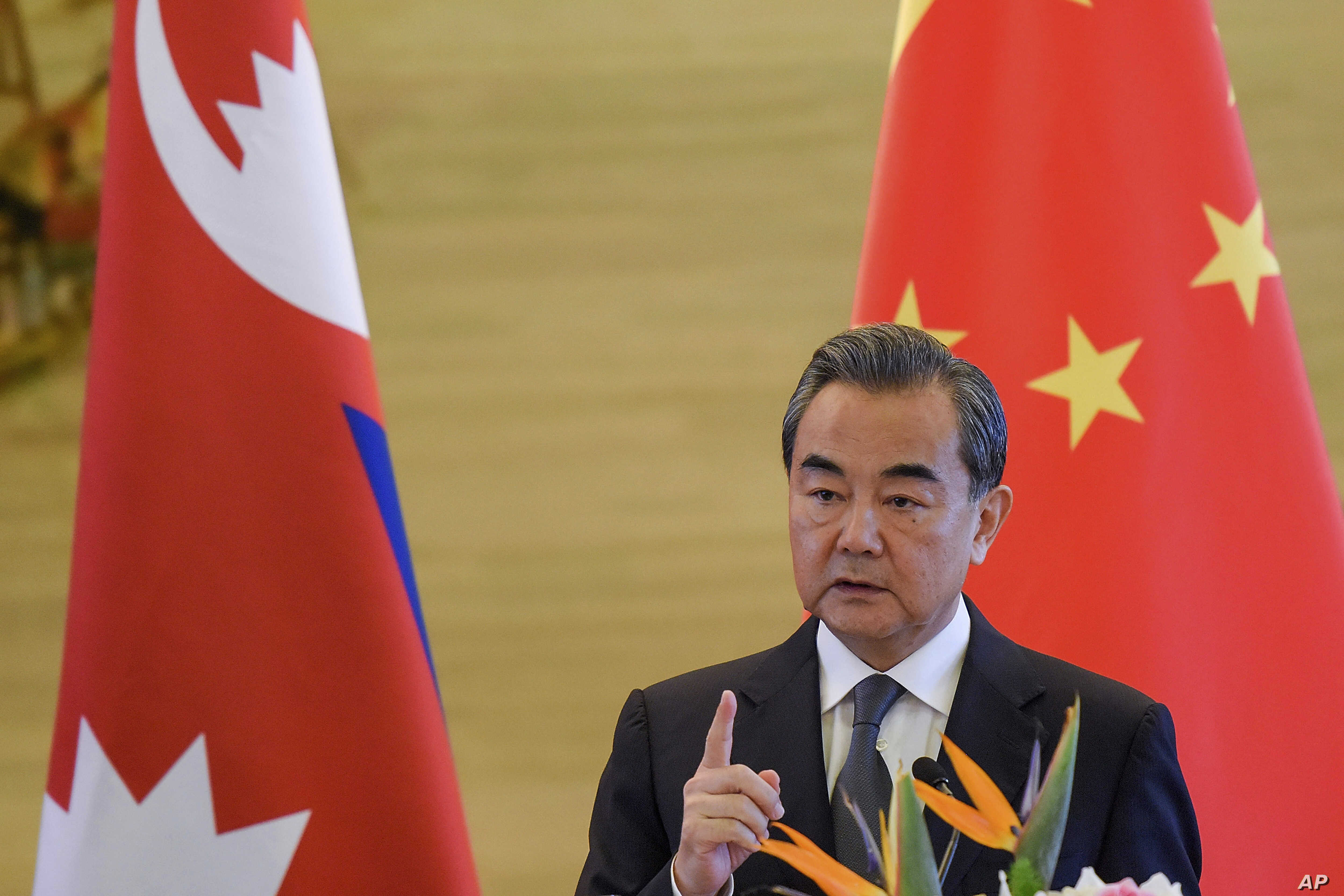 China's Foreign Minister Wang Yi speaks after a meeting with Nepal's Deputy Prime Minister Krishna Bahadur Mahara, Sept. 7, 2017, in Beijing.