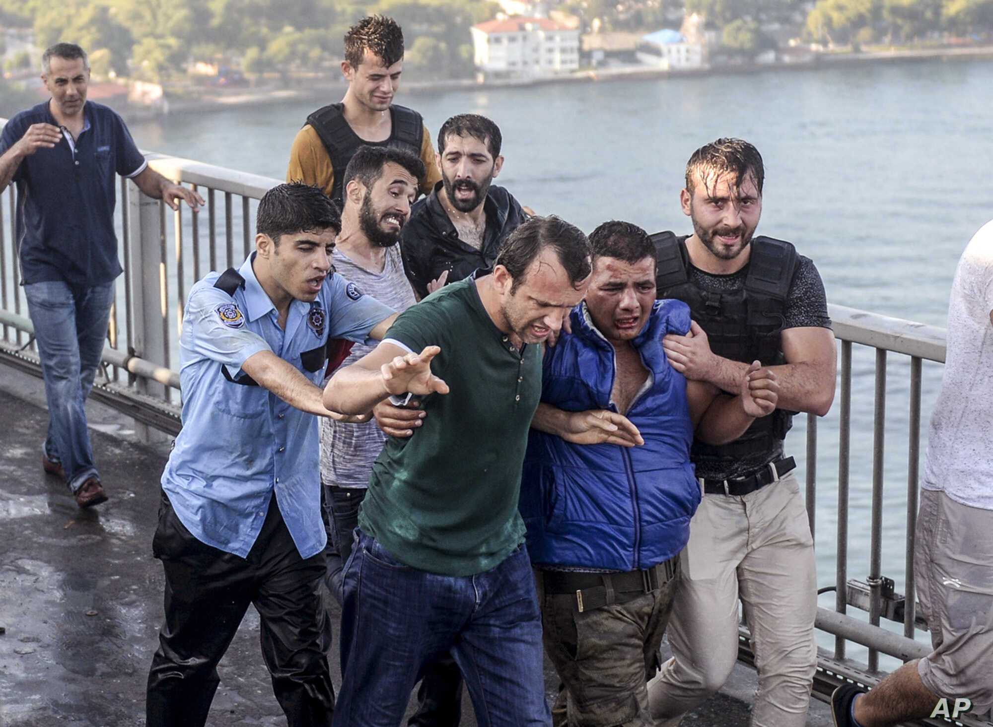 People apprehend a Turkish soldier that participated in the attempted coup, on Istanbul's Bosporus Bridge, July 16, 2016.