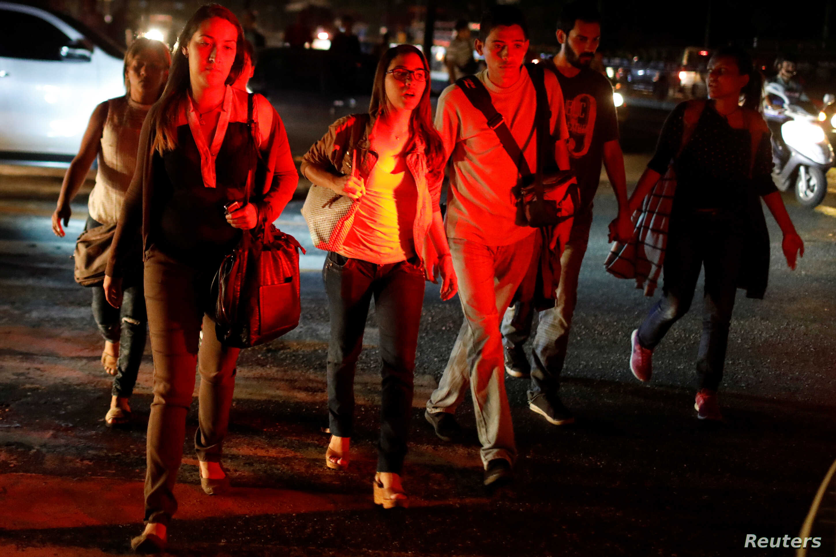 People walk on the street during a blackout in Caracas, Venezuela, March 7, 2019.