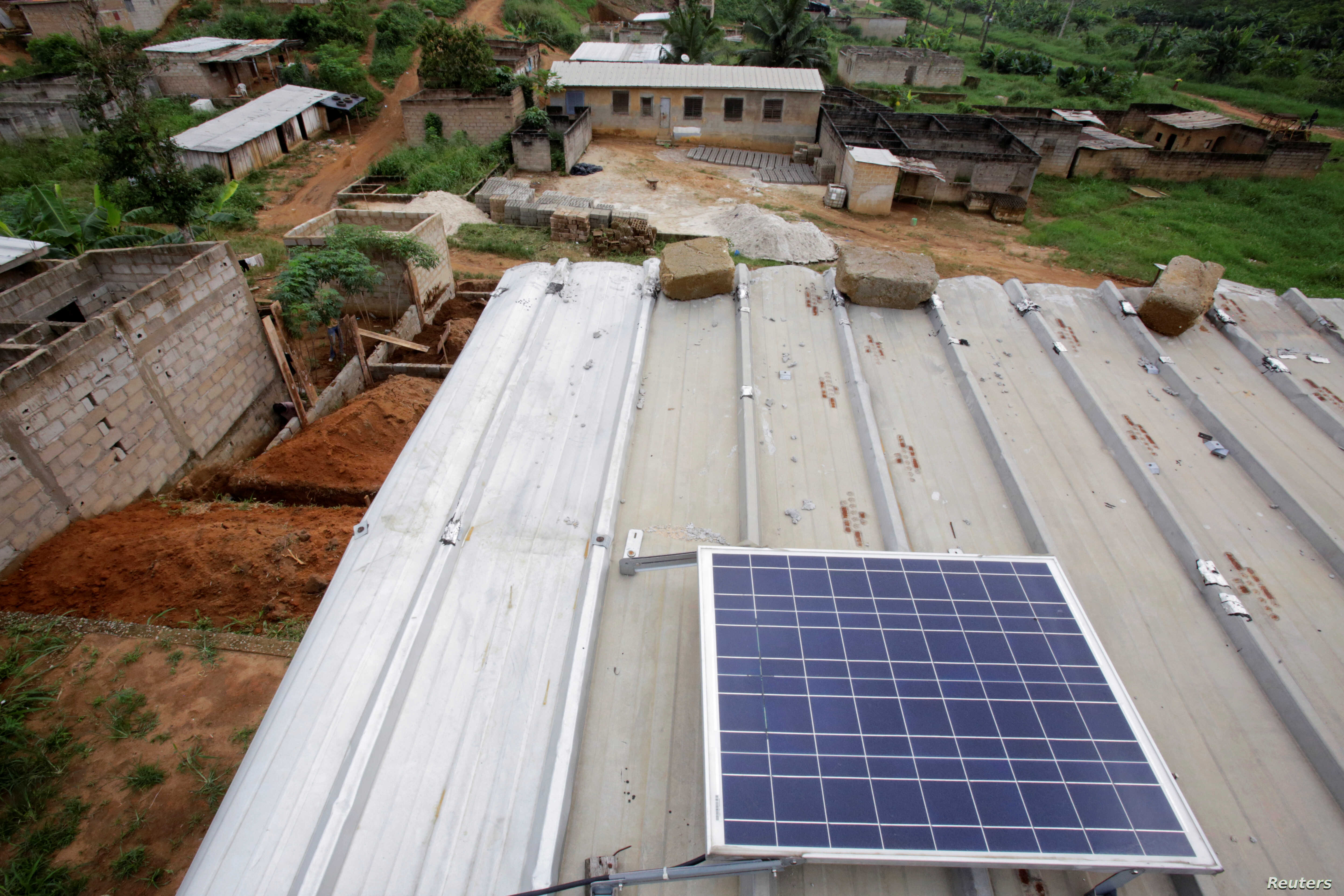 A solar panel is pictured on the roof of Jean-Noel Kouame's house, on the outer edge of  Abidjan, Ivory Coast,  Dec. 18, 2017.