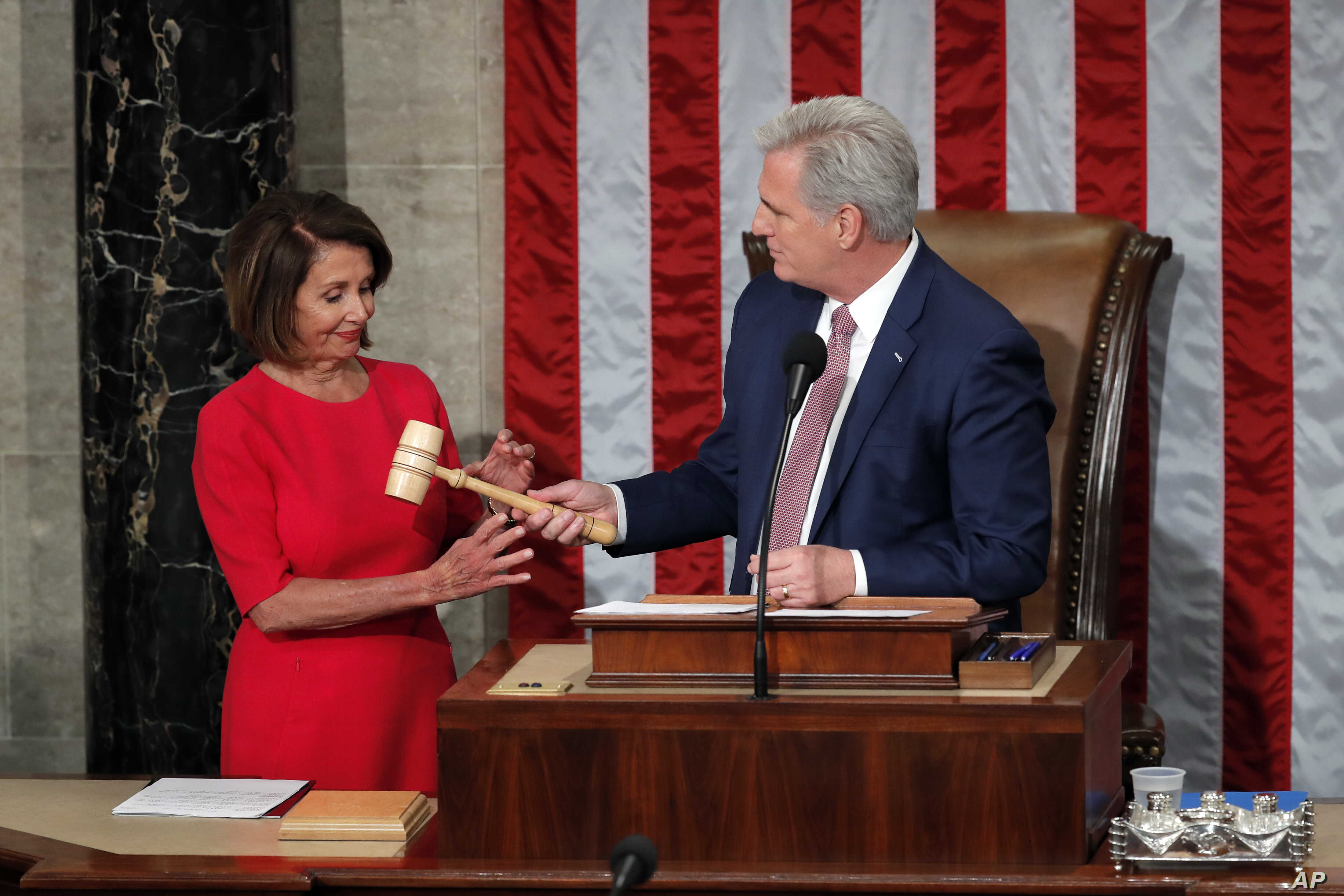 House speaker Nancy Pelosi of California, who will lead the 116th Congress as Speaker of the House is handed the gavel by Rep. Kevin McCarthy, R-Calif., at the U.S. Capitol in Washington, Jan. 3, 2019.