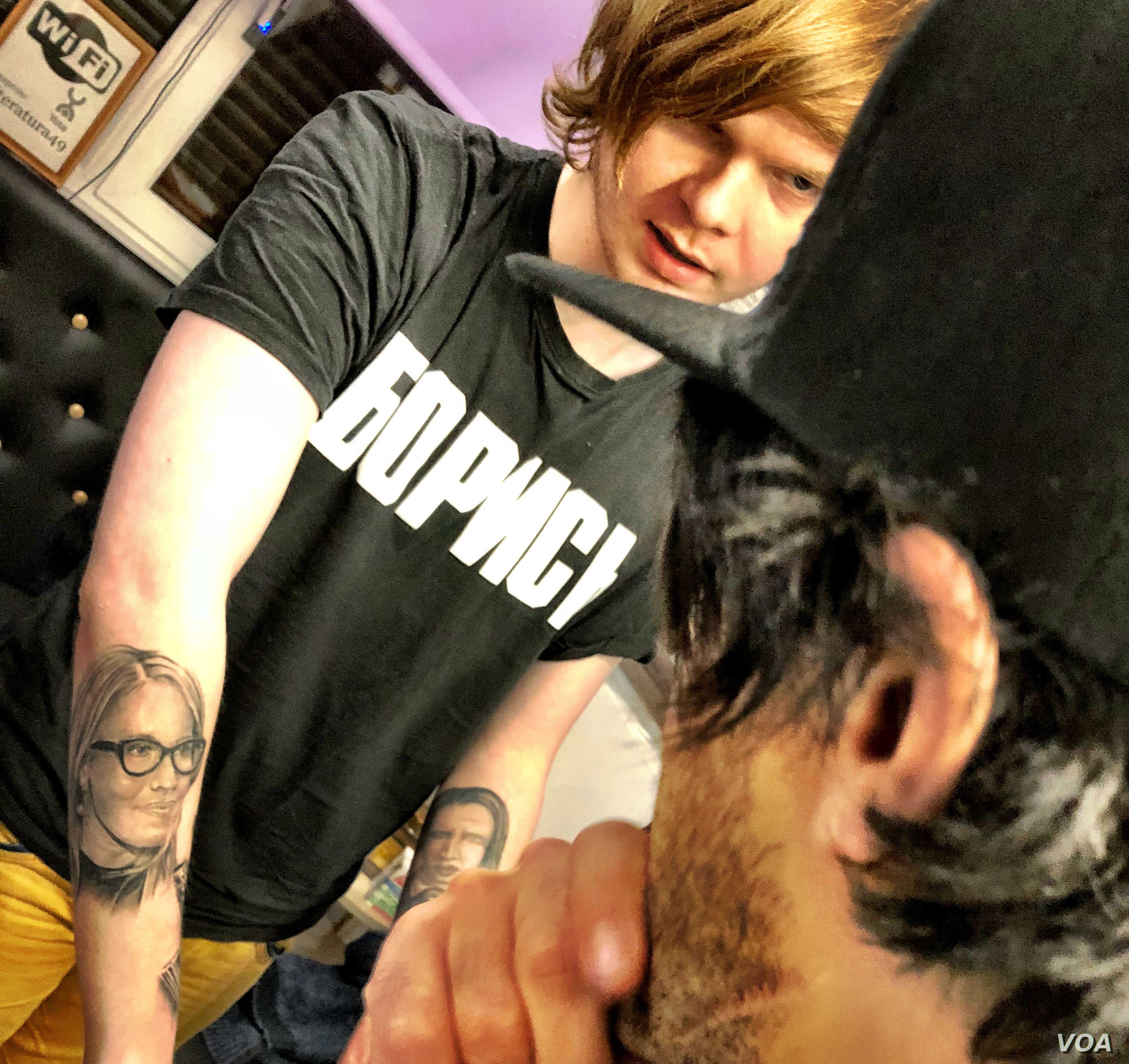 Russian journalist Vitaly Bespalov is seen at a St. Petersburg tattoo parlor in January 2018. Bespalov went undercover in 2014 to report on the Internet Research Agency. Amid attention on the IRA's role in the 2016 US presidential elections, Russian ...