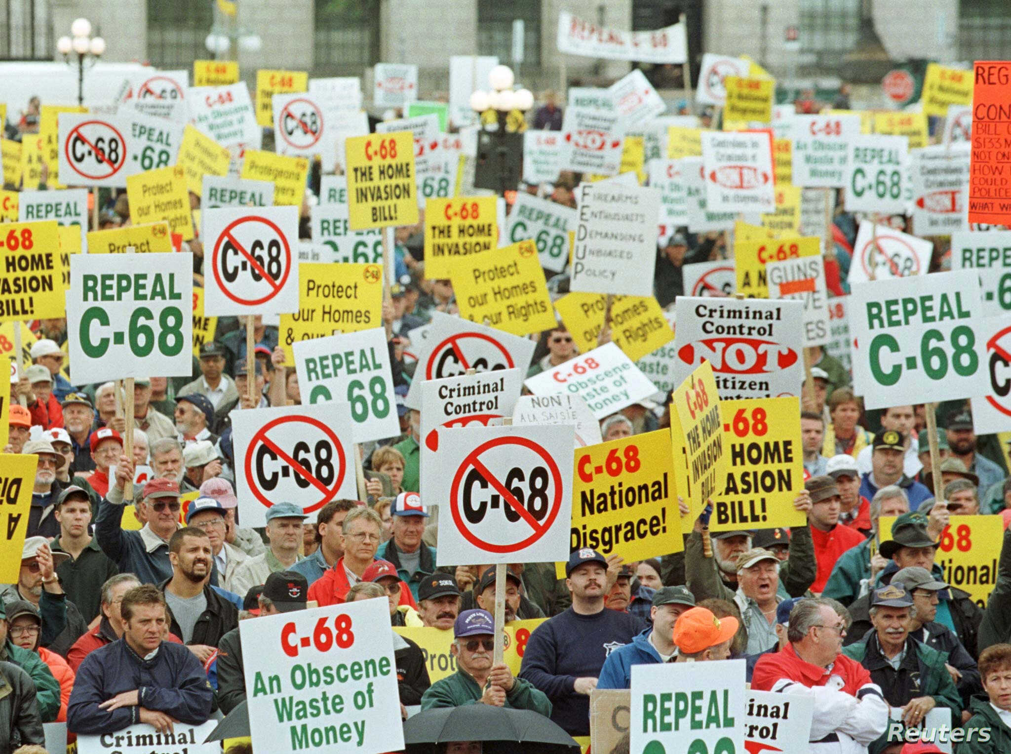 FILE - About 9,000 gun-owners, upset about the Liberals' attempt to create a national registry of all gun owners and their arms, rally on Parliament Hill to protest the Federal Government's tough new gun law, C-68, in Ottawa, Ontario, Canada, Sept. 2...