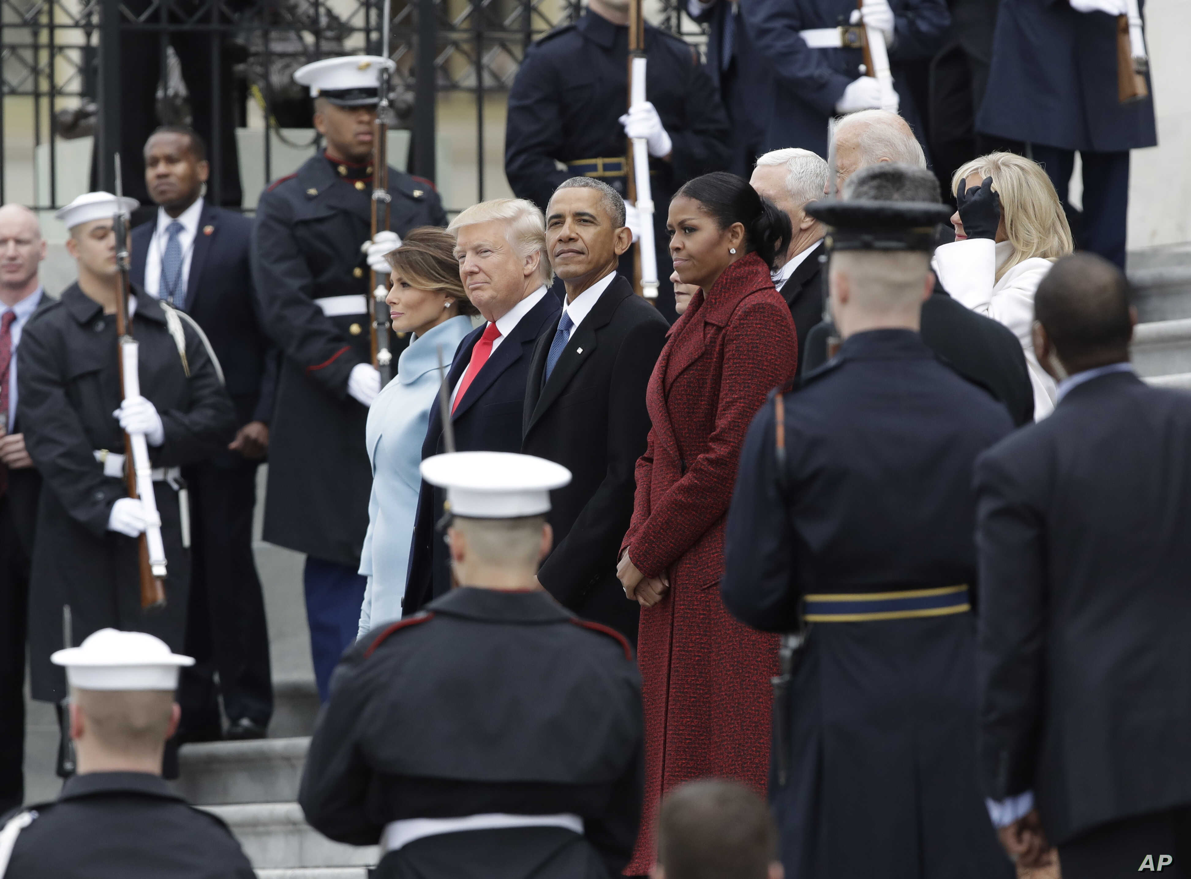Former President Barack Obama and his wife Michelle stand with President Donald Trump and first lady Melania Trump during a departure ceremony on the East Front of the U.S. Capitol in Washington, Jan. 20, 2017, after Trump was inaugurated.