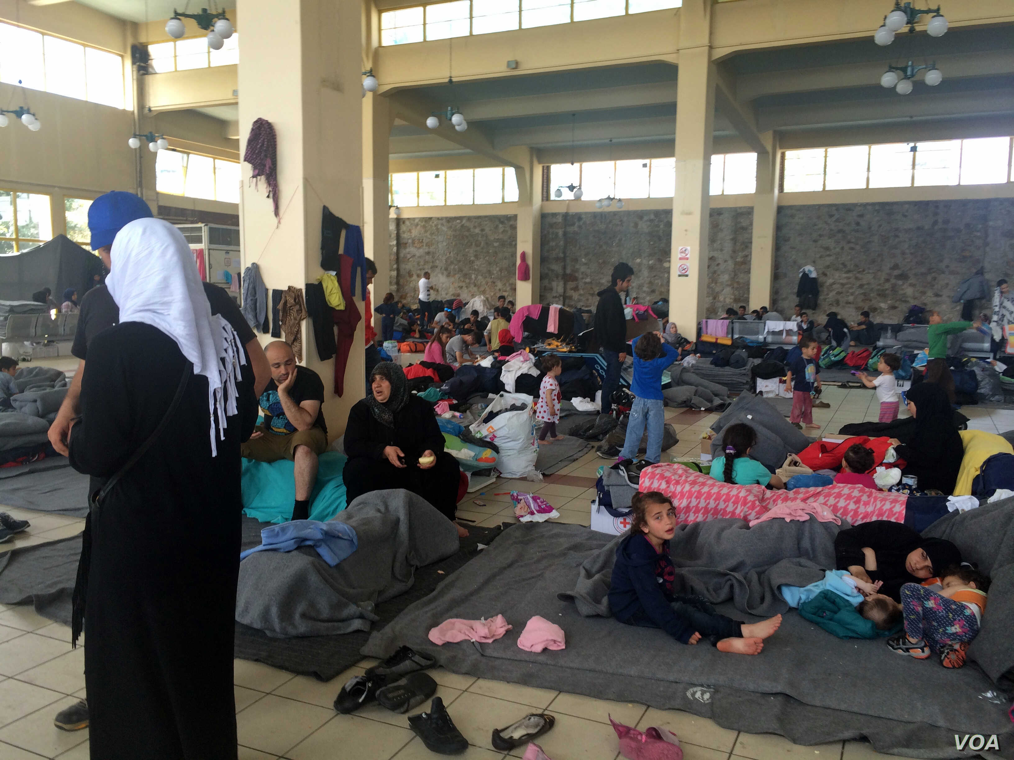 While most people camped out on Athens' Piraeus port sleep in plastic tents outside, some families with small children bunk in this port station, in increasingly unsanitary conditions in Athens, Greece on April, 8, 2016. (H. Murdock / VOA)