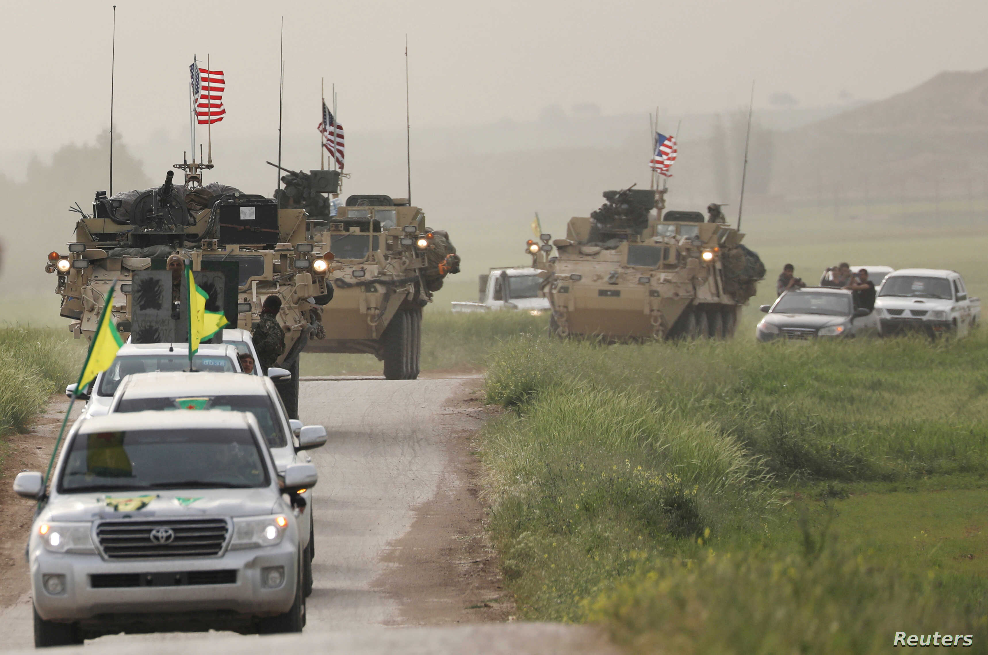 YPG Fighters and US military vehicles