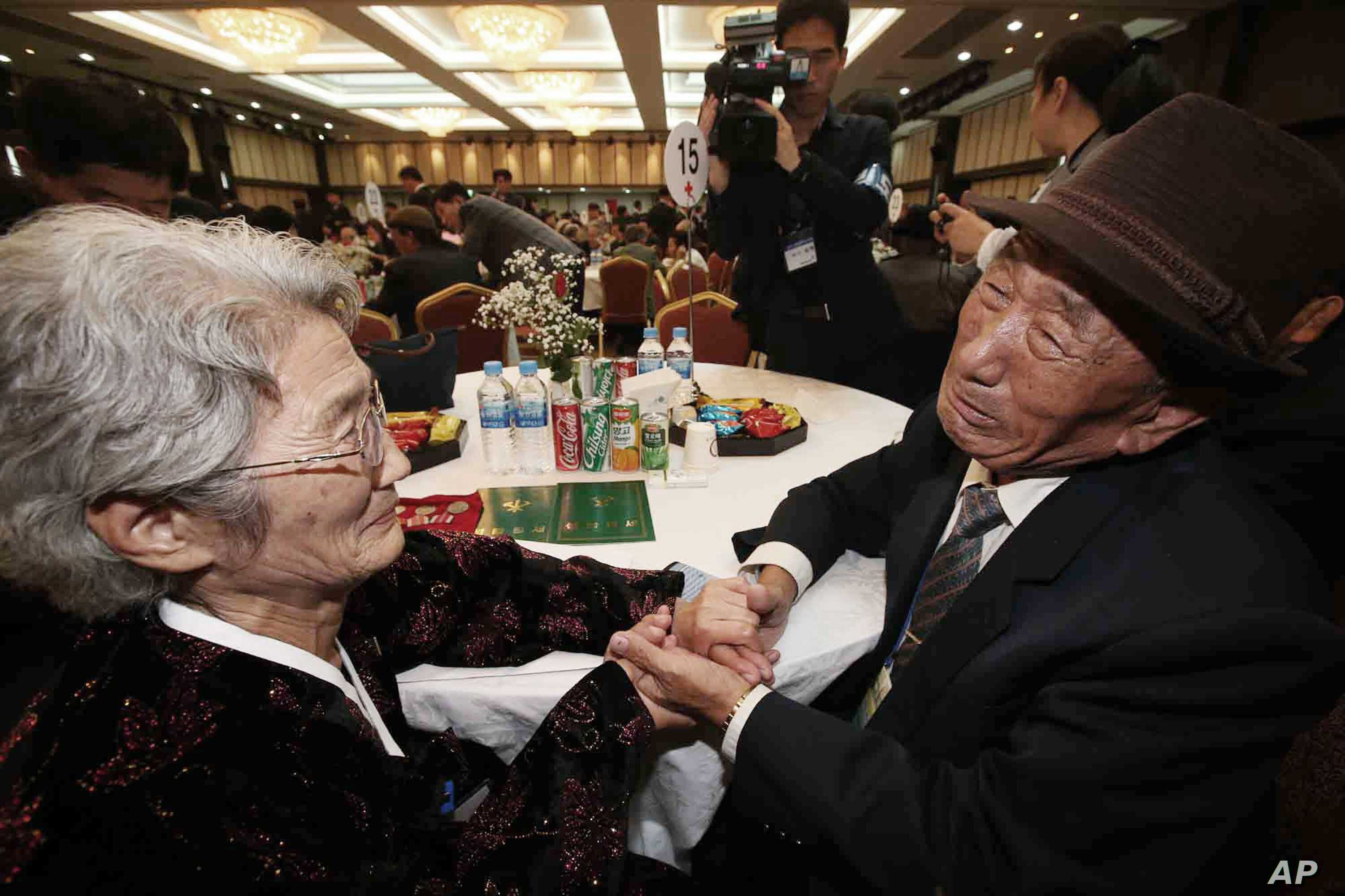 South Korean Kim Bock-rack, right, meets with his North Korean sister Kim Jeon Soon during the Separated Family Reunion Meeting at Diamond Mountain resort in North Korea, Oct. 20, 2015.