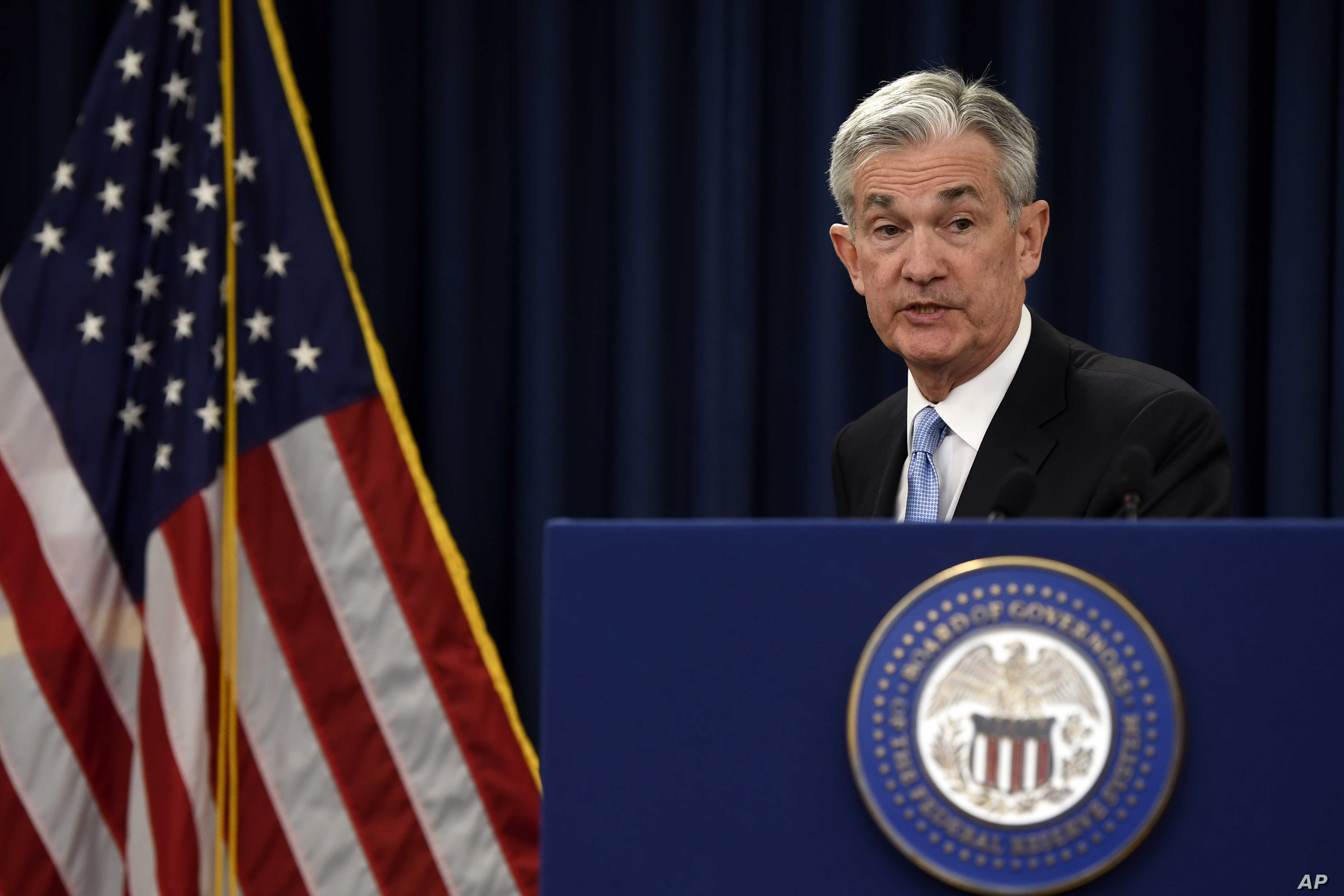 Federal Reserve Chair Jerome Powell gathers his notes as he concludes his news conference in Washington, March 20, 2019.