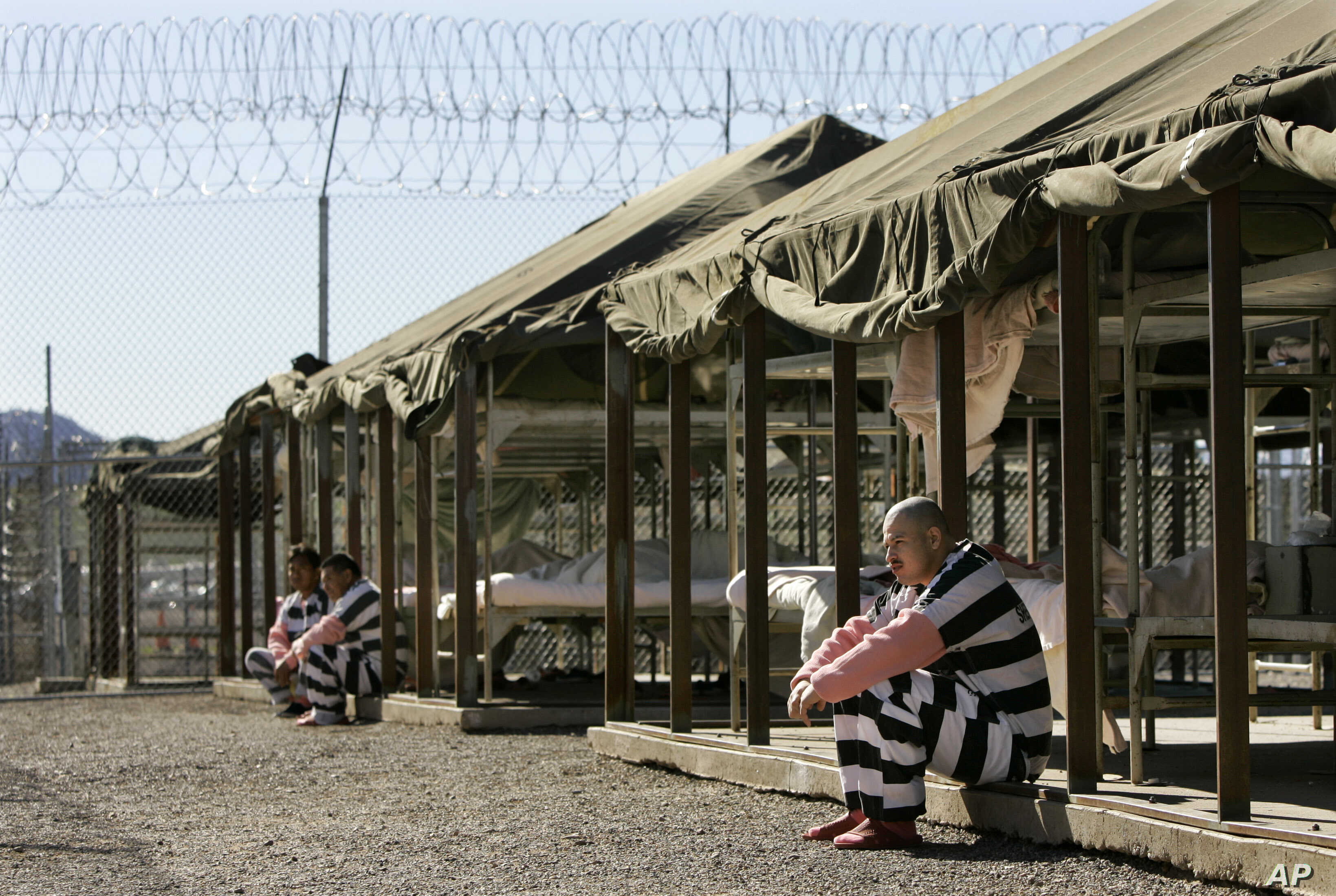 Inmates sit next to their bunks in the courtyard of Maricopa County Sheriff Joe Arpaio's jail in Phoenix, Arizona, Jan. 31, 2008.