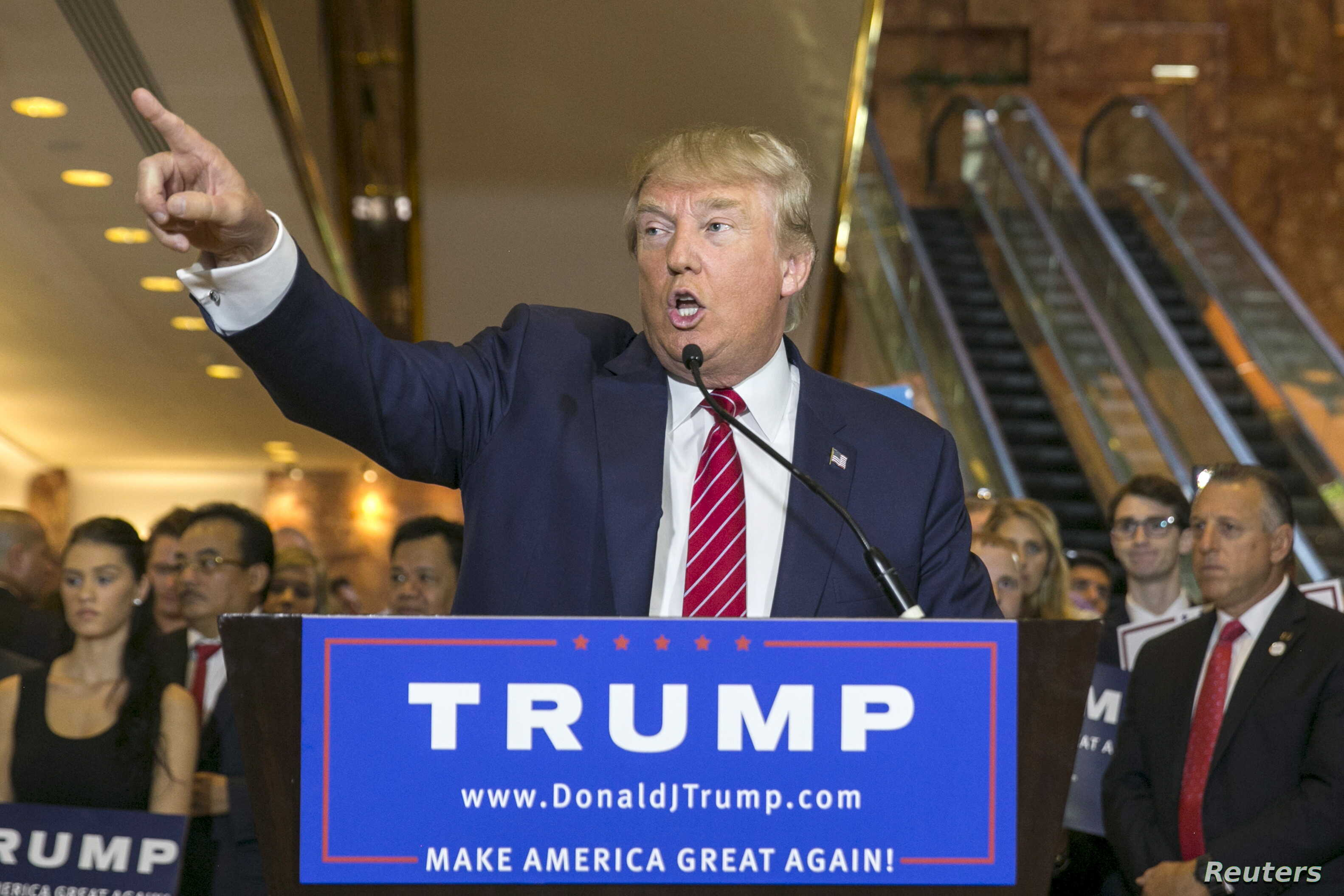 U.S. presidential hopeful Donald Trump speaks during a press availability after signing a pledge with the  Republican National Committee  (RNC) at Trump Tower in Manhattan, New York, Sept. 3, 2015.