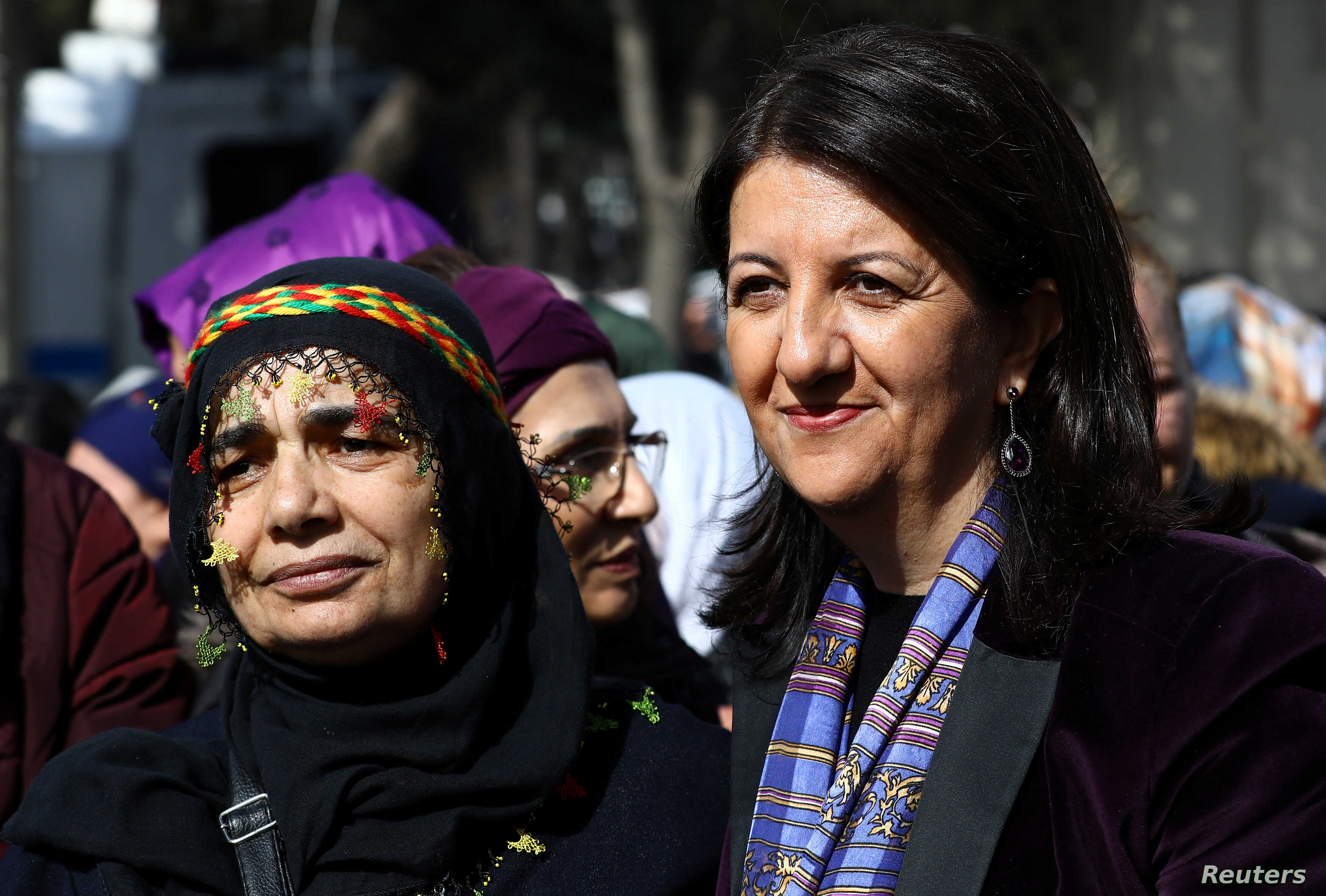 FILE - Pervin Buldan, right, a co-leader of Turkey's main pro-Kurdish Peoples' Democratic Party (HDP), poses with a supporter during a Women's Day rally in Istanbul, Turkey, March 4, 2018.