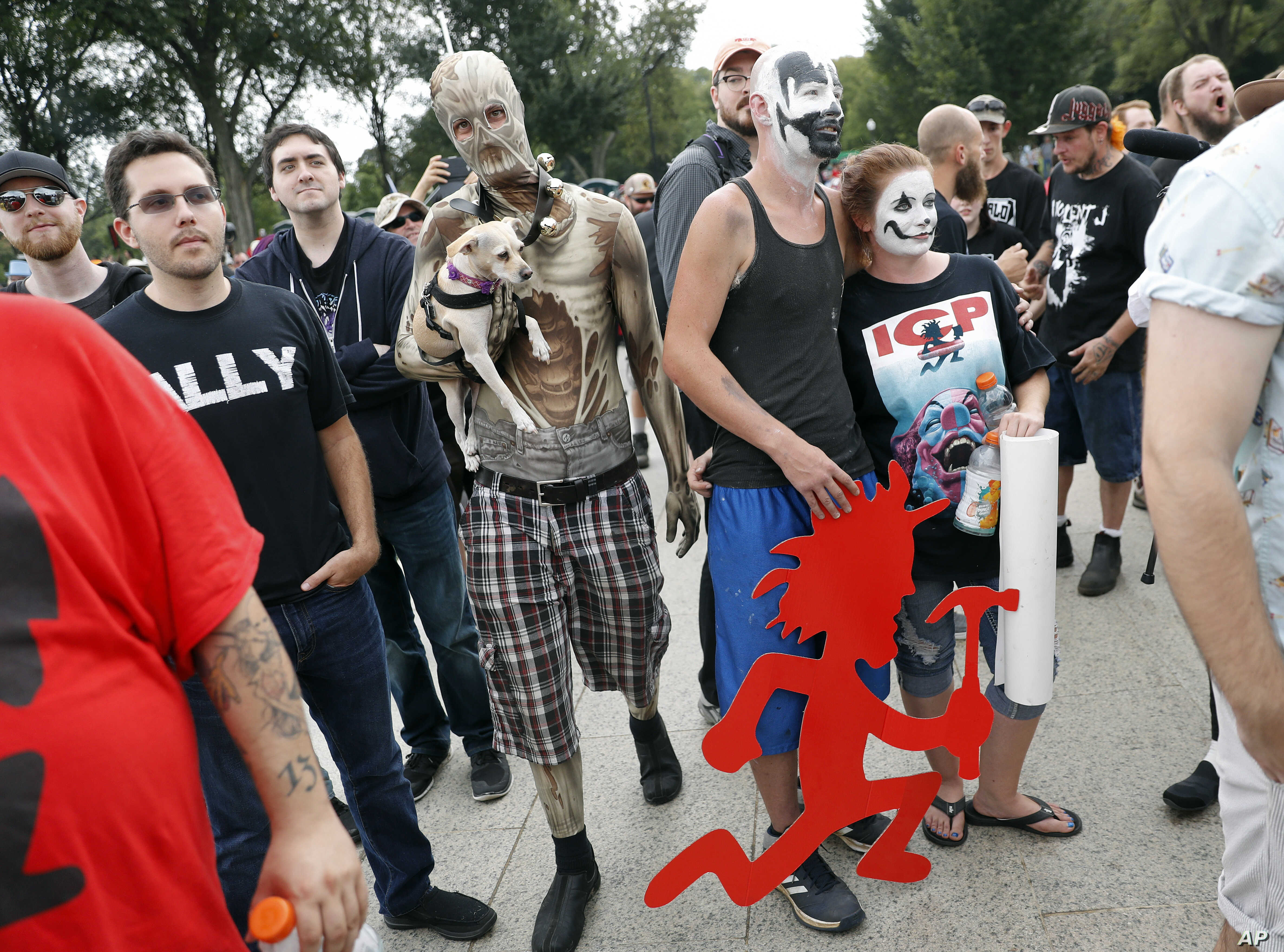 "Juggalos, as supporters of the rap group Insane Clown Posse are known, gather in front of the Lincoln Memorial in Washington during a rally, Sept. 16, 2017, to protest and demand that the FBI rescind its classification of the juggalos as ""loosely org..."