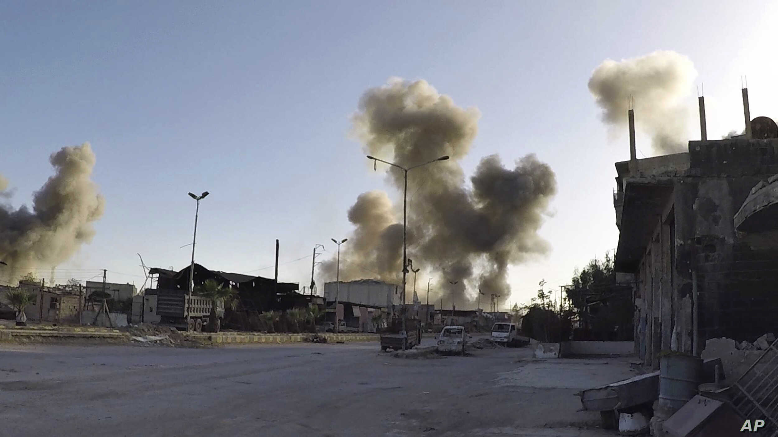 This photo released by the Syrian Civil Defense White Helmets, which has been authenticated based on its contents and other AP reporting, shows smoke rising after Syrian government airstrikes hit in the town of Douma, in eastern Ghouta region east of...