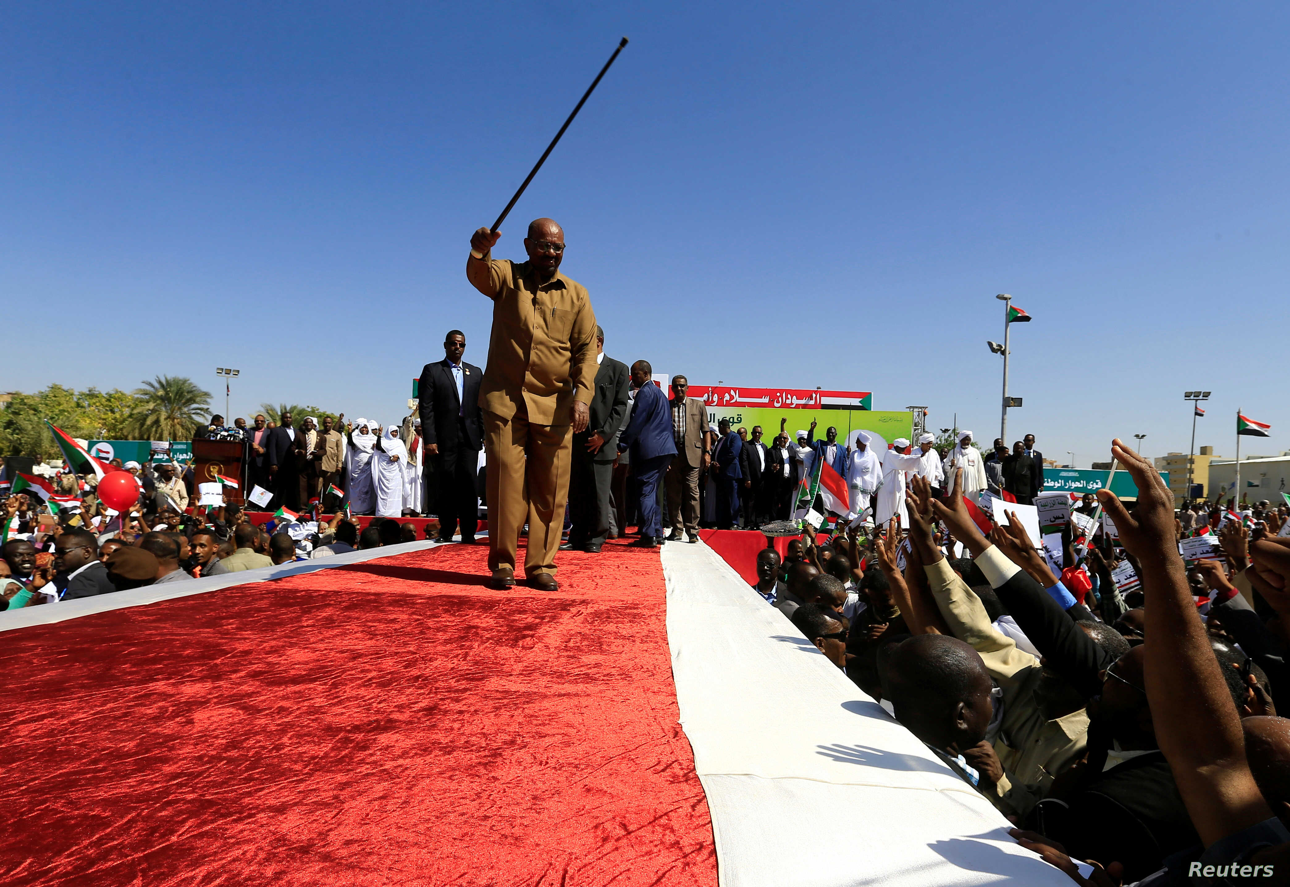 Sudan's President Omar al-Bashir waves to his supporters during a rally at the Green Square in Khartoum, Sudan, Jan. 9, 2019.