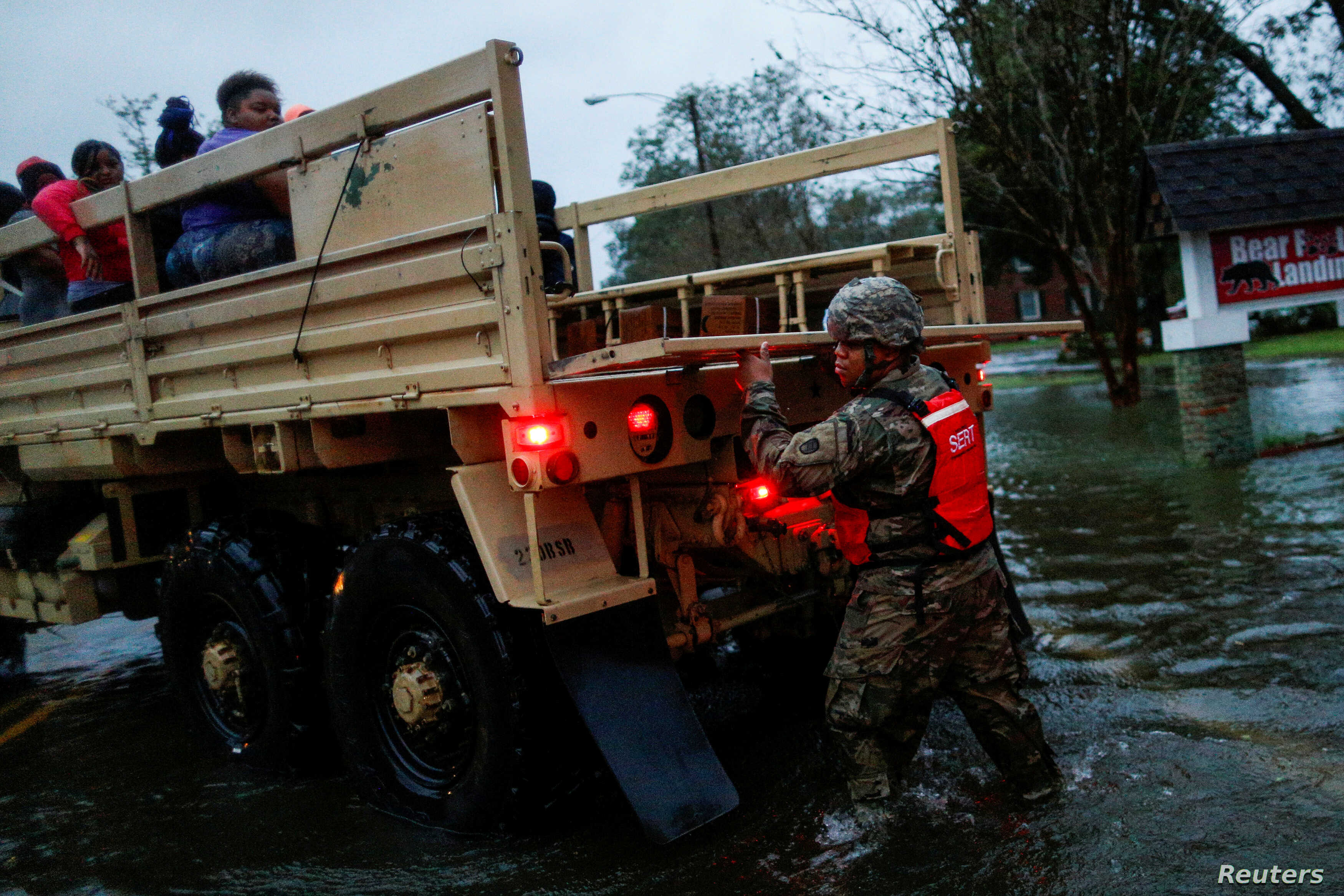 People are rescued by a member of the U.S. Army during the passing of Hurricane Florence in the town of New Bern, North Carolina, Sept. 14, 2018.
