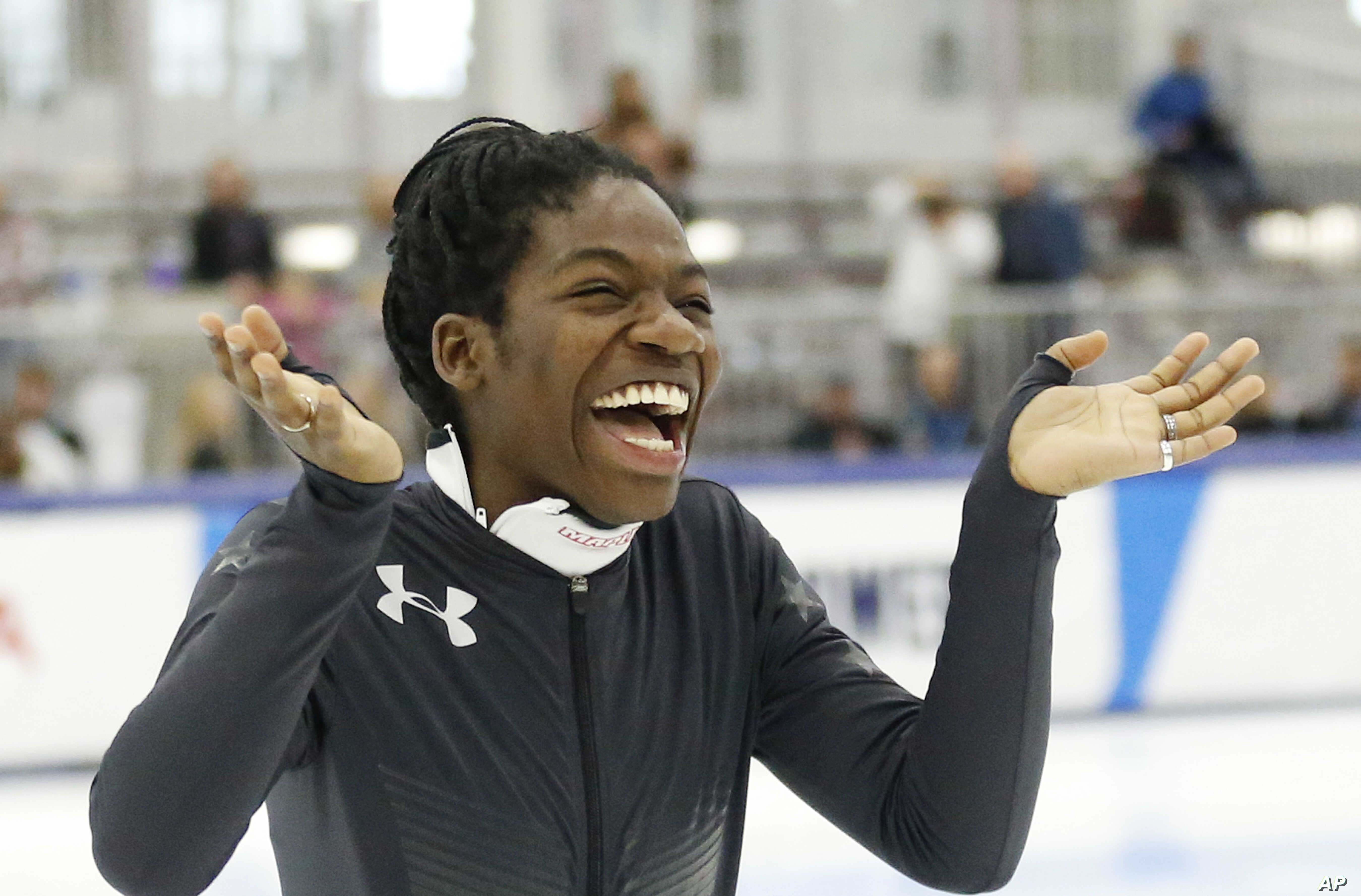 Maame Biney reacts during a medal ceremony after winning women's 500-meter A final race during the U.S. Olympic short track speedskating trials, Dec. 16, 2017, in Kearns, Utah.