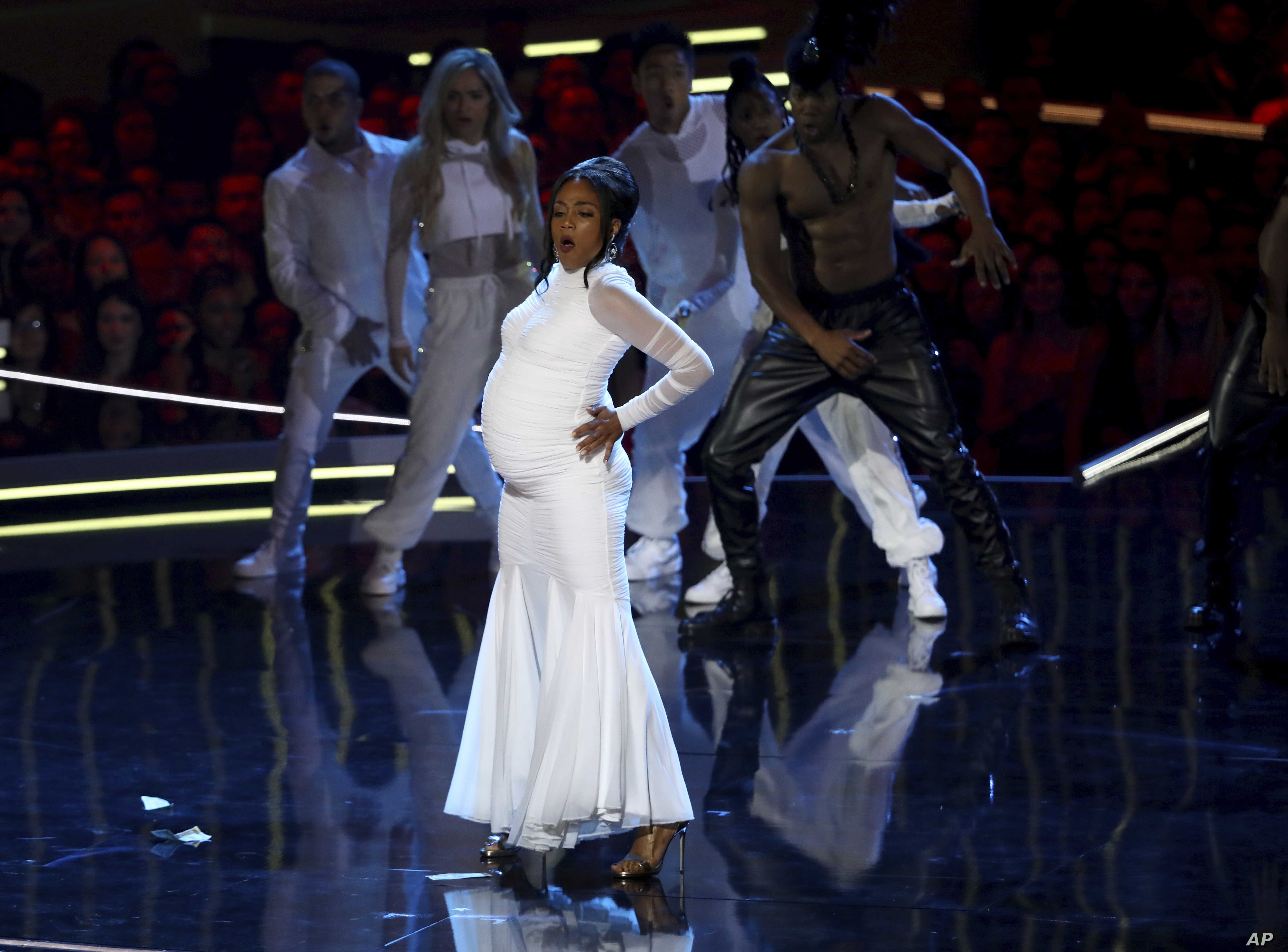 "In this Saturday, June 16, 2018, photo, Tiffany Haddish performs a rendition of ""Bodak Yellow"" at the start of the MTV Movie and TV Awards at the Barker Hangar in Santa Monica, Calif."