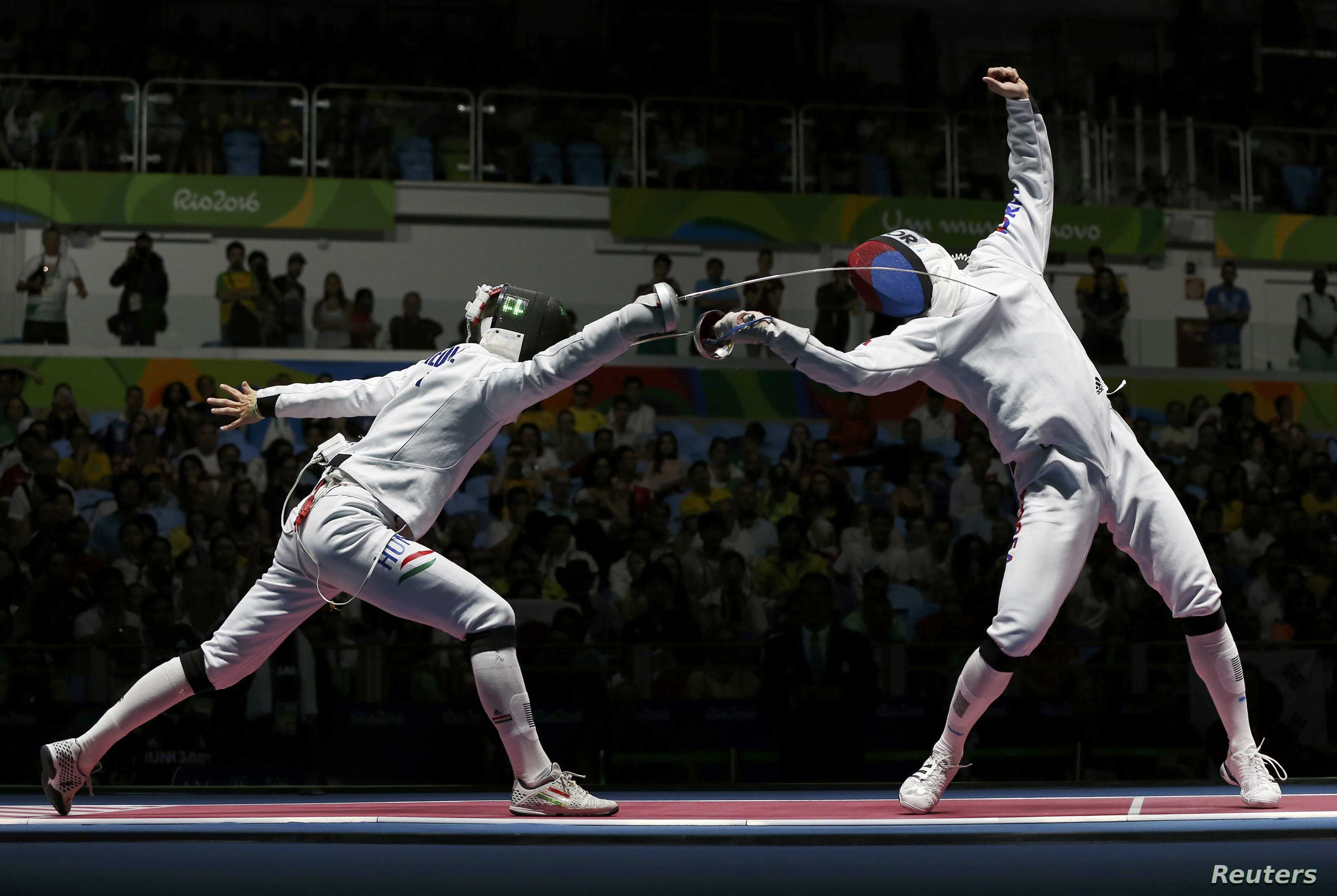 Andras Redli (HUN) of Hungary competes with Jung Jin-Sun (KOR) of South Korea in the Men's Epee Team Quarterfinals, Aug. 14, 2016.