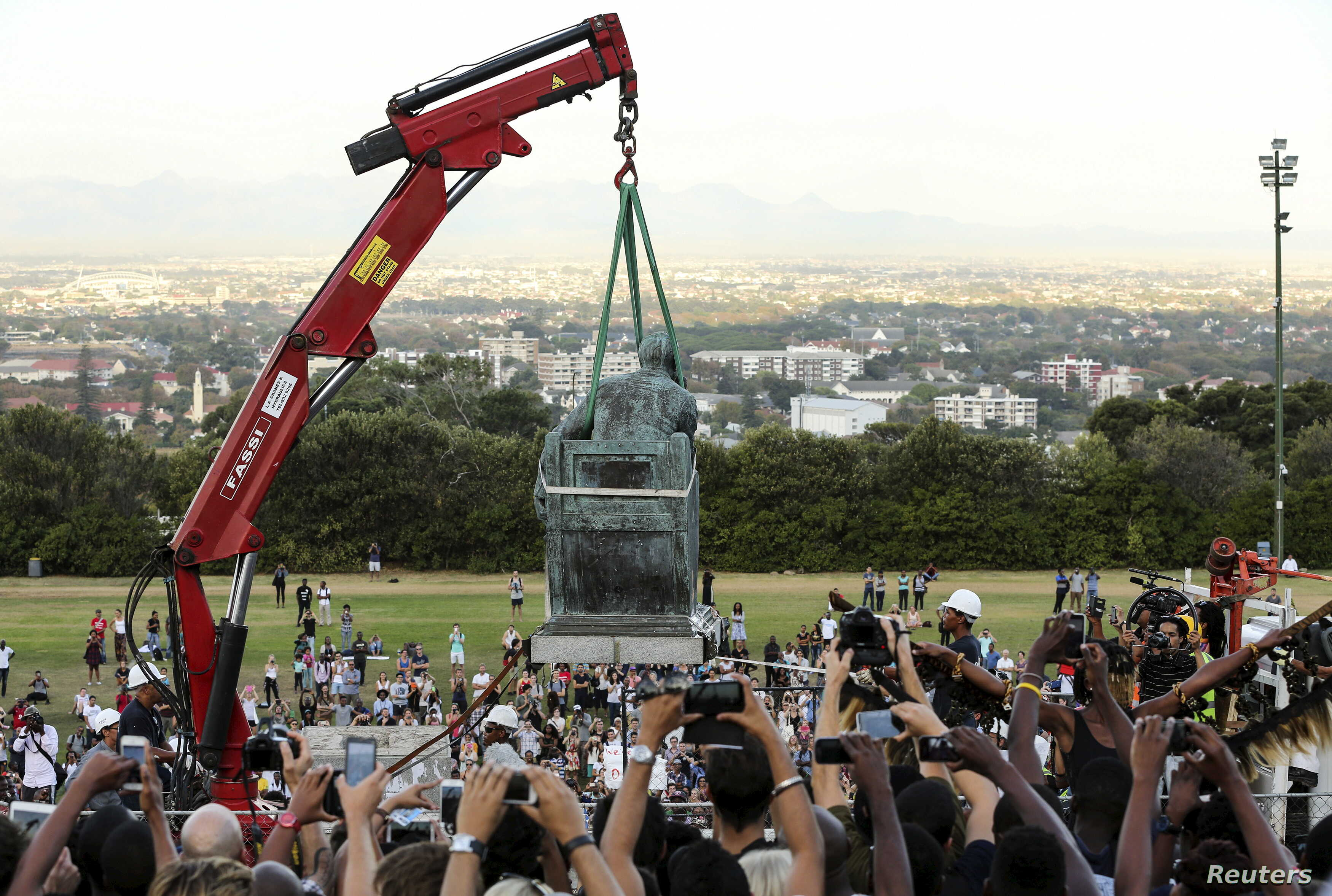 Students cheer as the statue of Cecil John Rhodes is removed from the University of Cape Town (UCT) in South Africa, April 9, 2015.