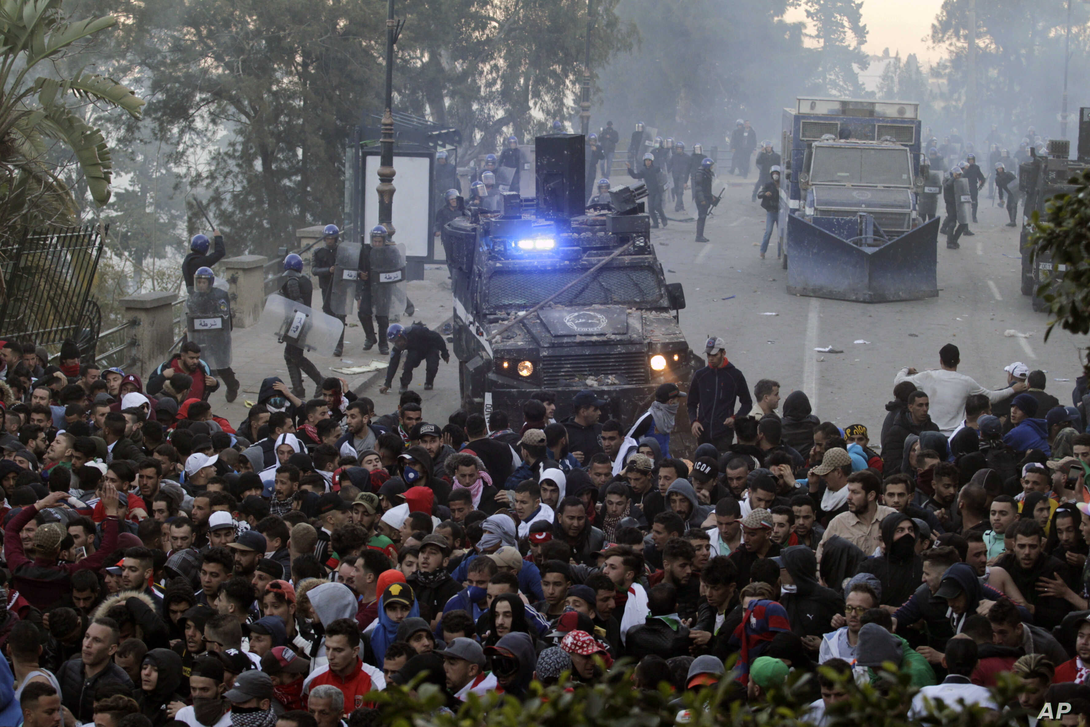 Protesters clash with police in the streets of Algiers, Algeria, during a demonstration denouncing President Abdelaziz Bouteflika's bid for a fifth term, March 1, 2019.