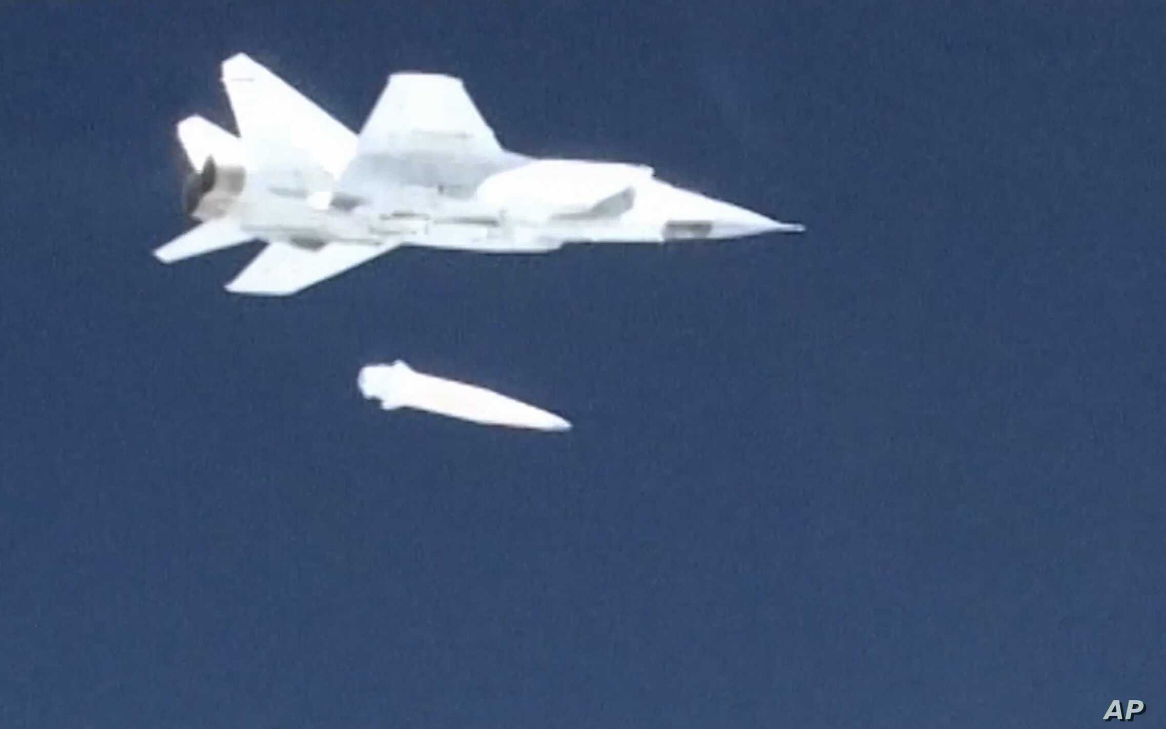 In this video grab provided by RU-RTR Russian television via AP television on March 1, 2018, a Russian MiG-31 fighter jet releases the new Kinzhal hypersonic missile during a test at an undisclosed location in Russia.