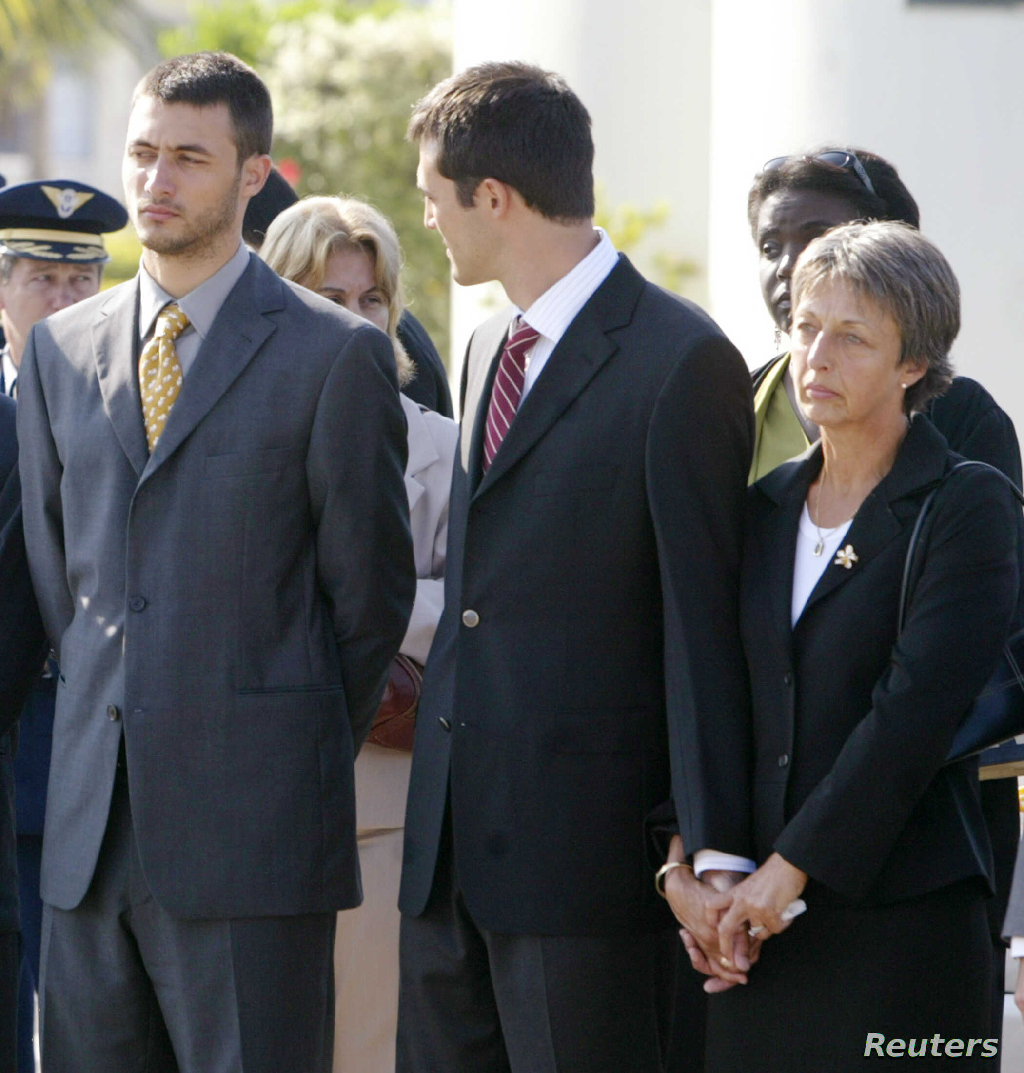 FILE - Annie Vieira (R), widow of Brazilian diplomat, Sergio Vieira de Mello, stands in mourning with her sons Laurent (L) and Adrian upon the arrival of Vieira de Mello's body at a military air base in Rio de Janeiro, Aug. 23, 2003.