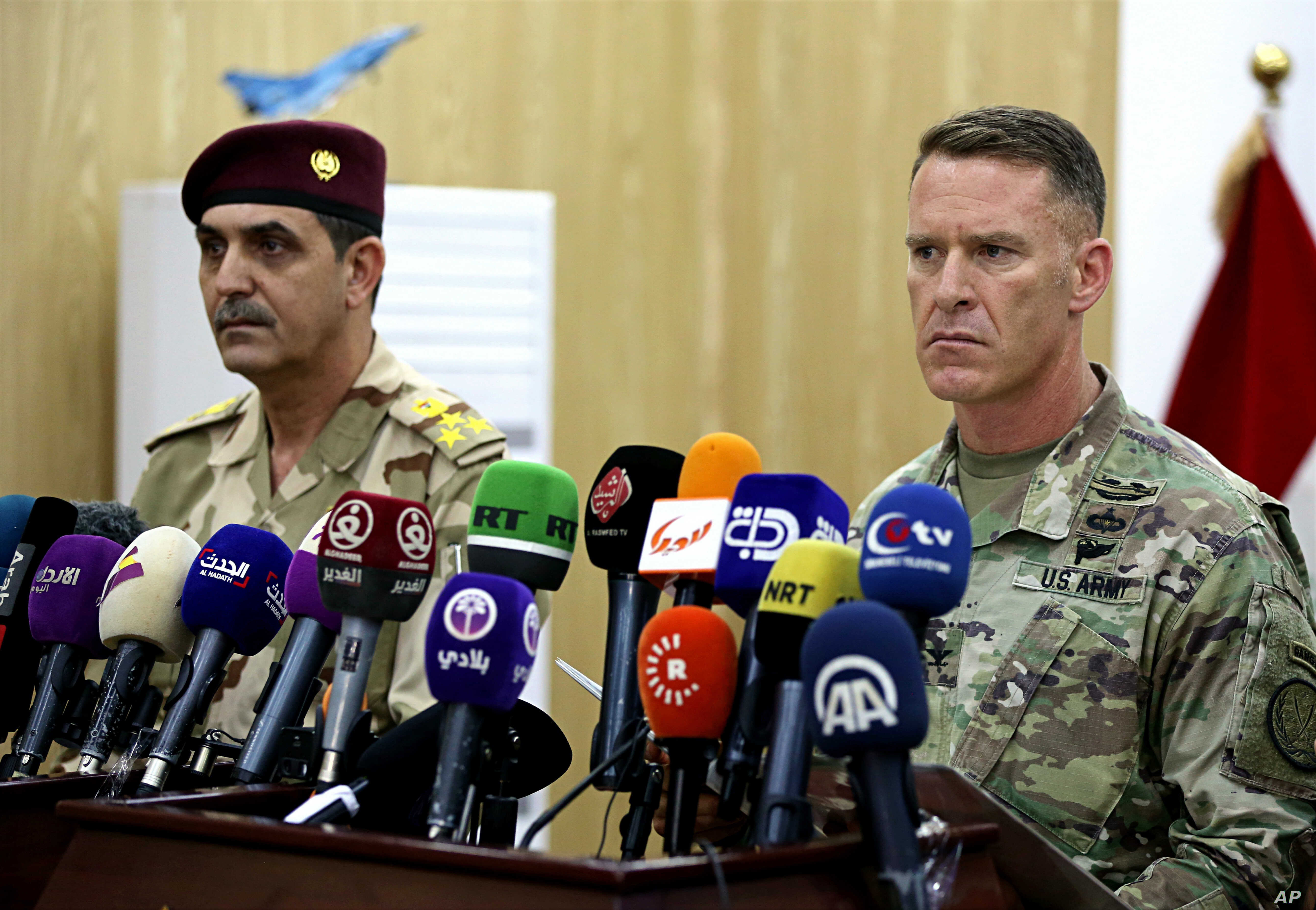 U.S. Army Col. Ryan Dillon, spokesman for Operation Inherent Resolve, the U.S.-led coalition against the Islamic State group, right, and Iraq armed forces spokesman Gen. Yahyah Rasul hold a press conference in Baghdad, Iraq, Thursday, Sept. 21, 2017....
