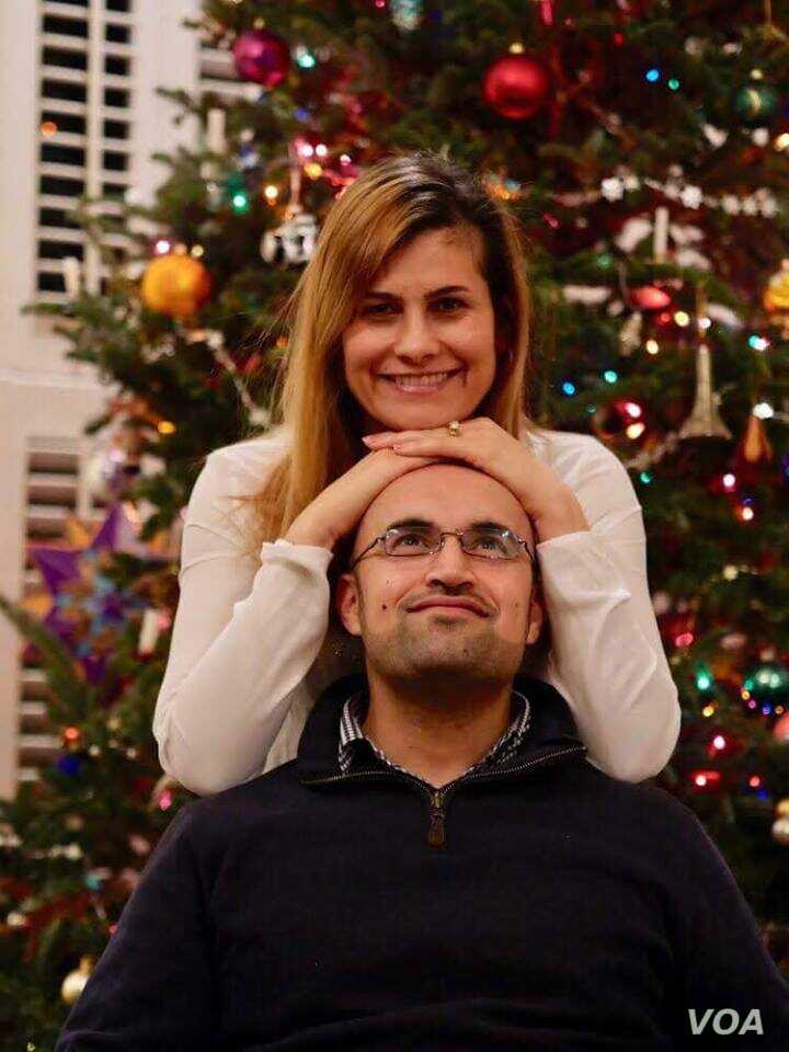 Lilah Salih, a Yazidi woman from a village outside Sinjar in northern Iraq, resettled in the U.S. with her husband in 2017. They are pictured here celebrating Christmas that year.