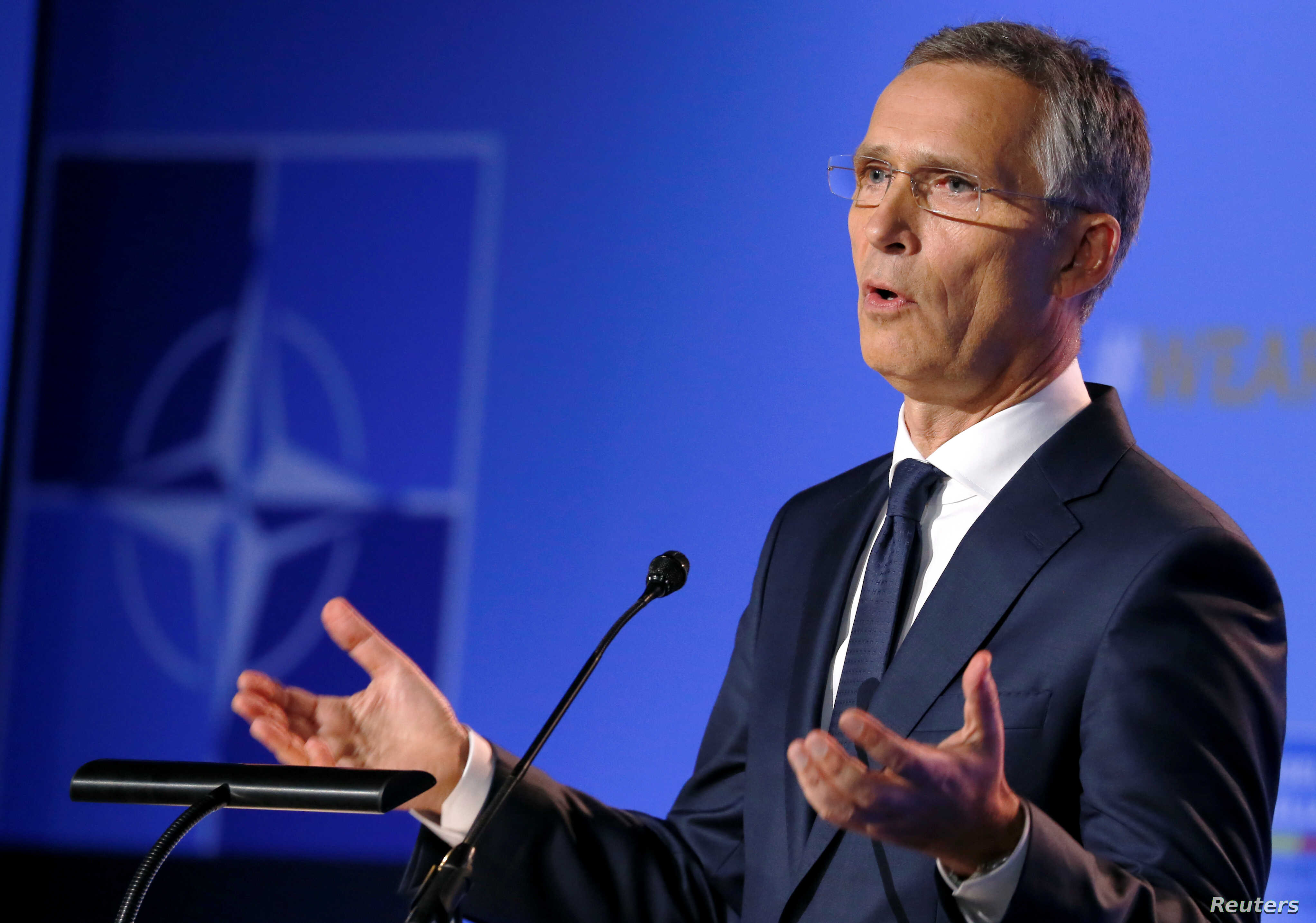 NATO Secretary-General Jens Stoltenberg gestures as he holds a news conference during the NATO summit in Brussels, Belgium, July 11, 2018.